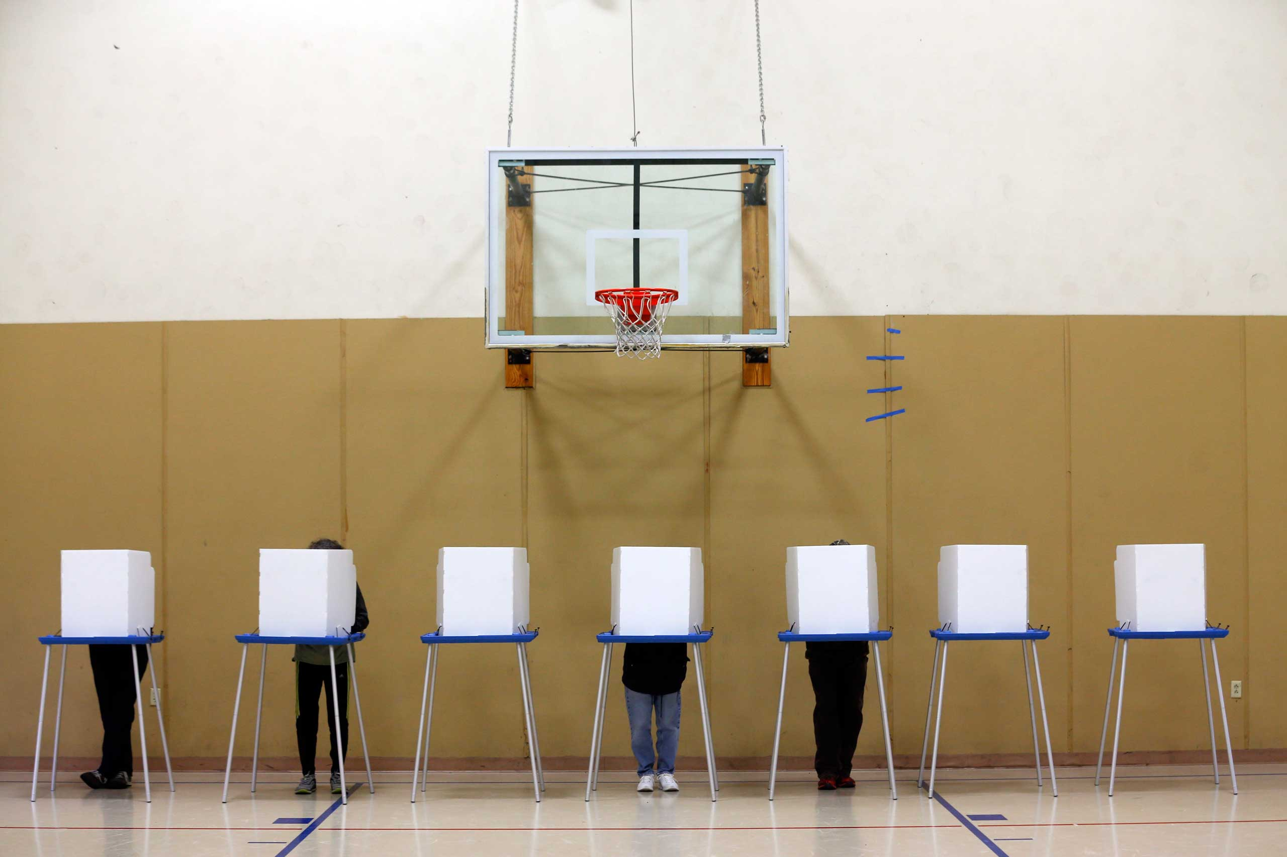 Voters fill out their ballots in a gym on election day at St. Sophia Greek Orthodox Church in Albany, N.Y. on Nov. 4.