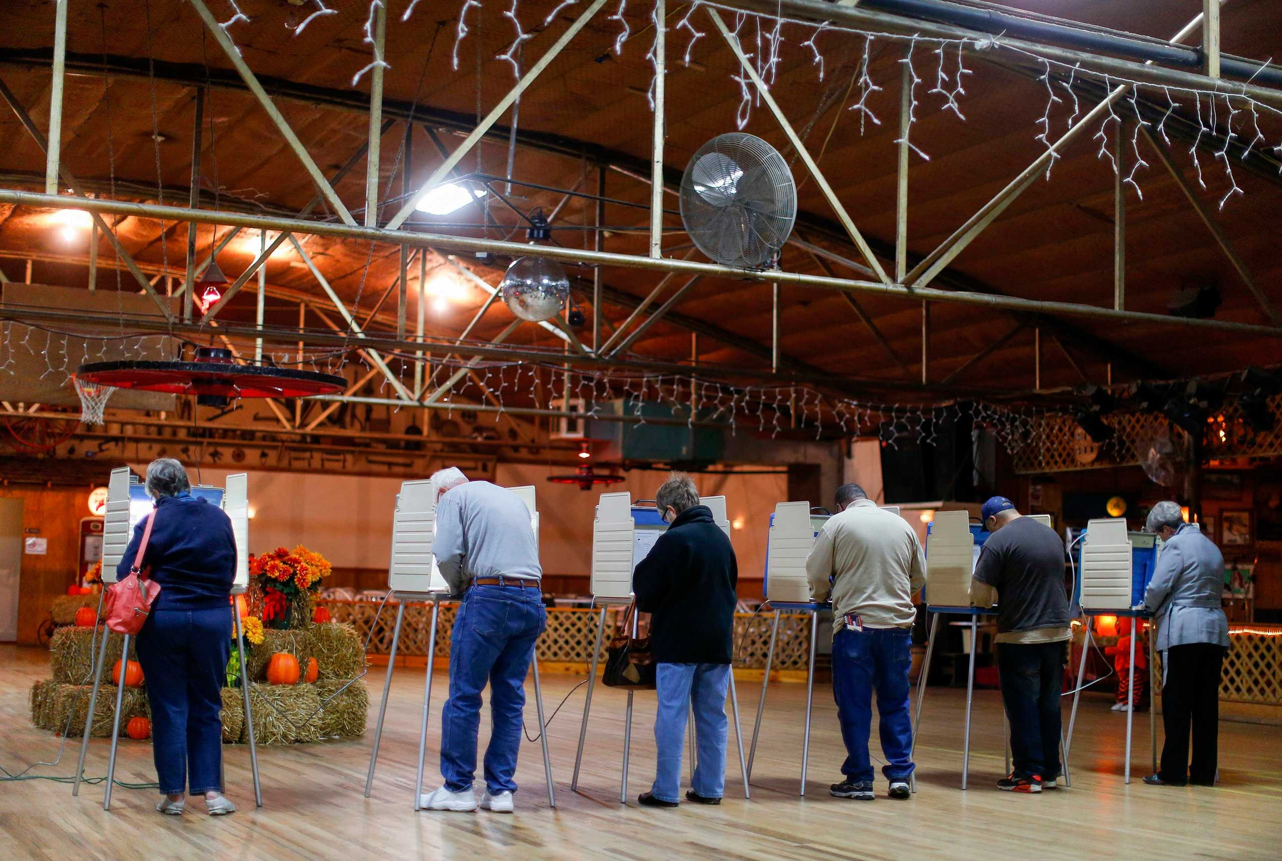 Voters fill in their ballots at a polling place located in Shoaf's Wagon Wheel in Salisbury, N.C. on Nov. 4, 2014.