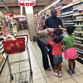 A family shops in a supermarket in Kinshasa, Democratic Republic of Congo, July 4th, 2014.