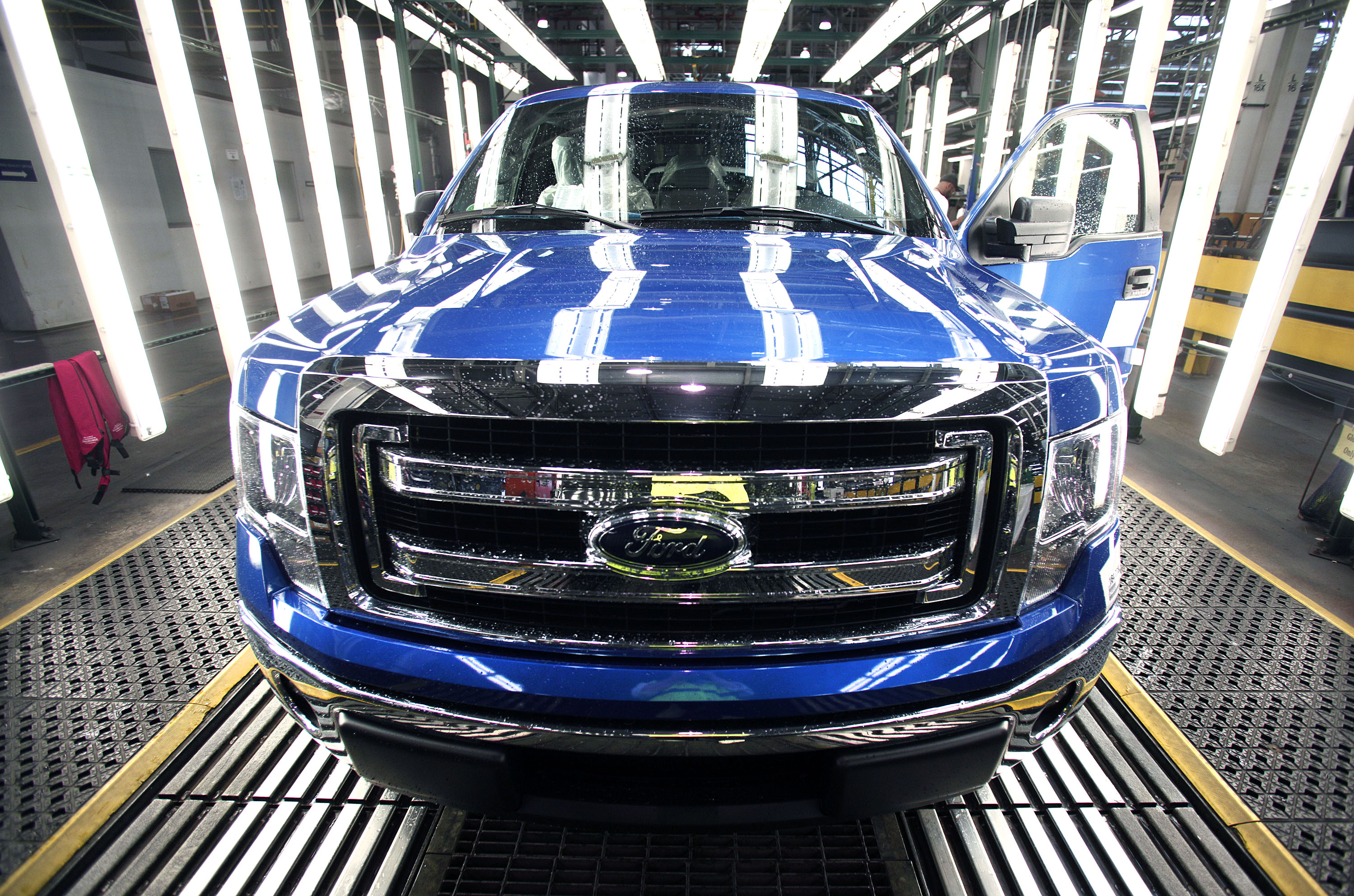 A new 2014 Ford F-150 truck exits a quality control inspection after undergoing  assembly at the Ford Dearborn Truck Plant on June 13, 2014 in Dearborn, Mich.