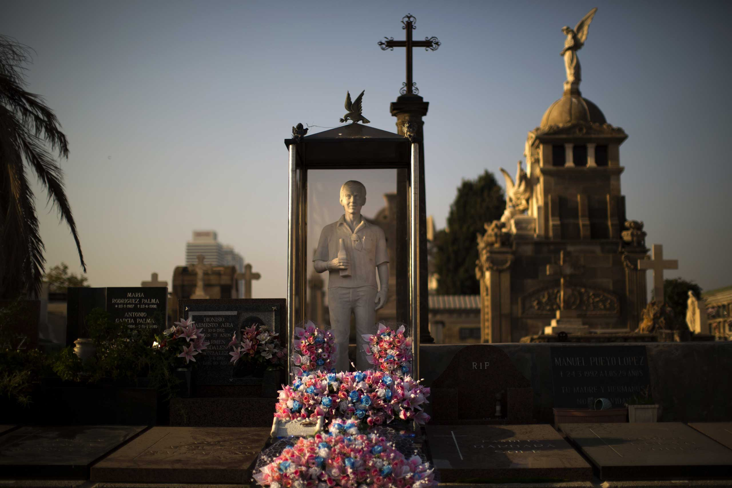 Nov. 1, 2014. A tomb is decorated with flowers in Barcelona during All Saints Day, a Catholic holiday to reflect on the saints and deceased relatives.