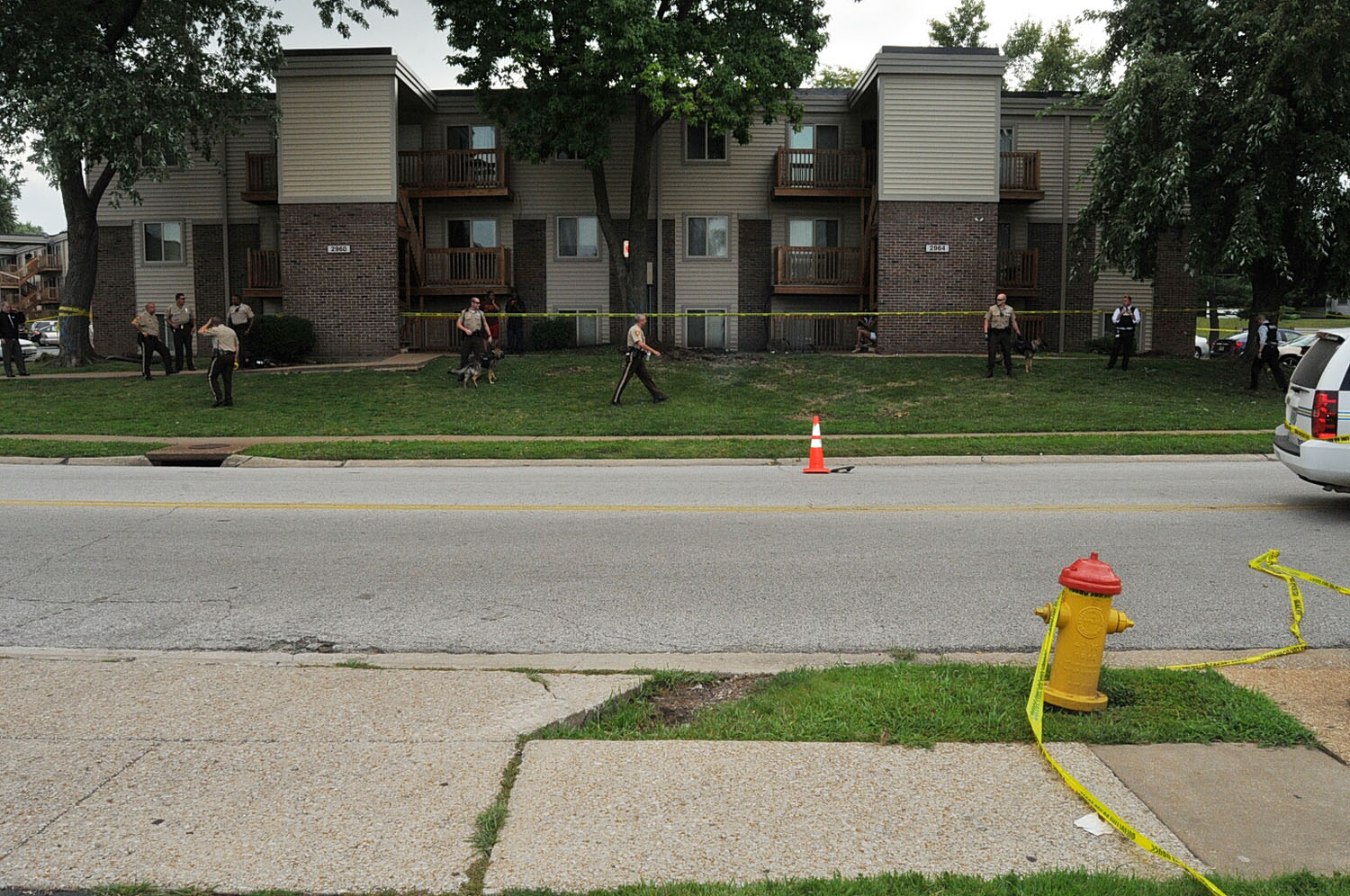 A traffic cone and police tape mark the scene near where Brown was shot on Canfield Drive in Ferguson, Mo. in August