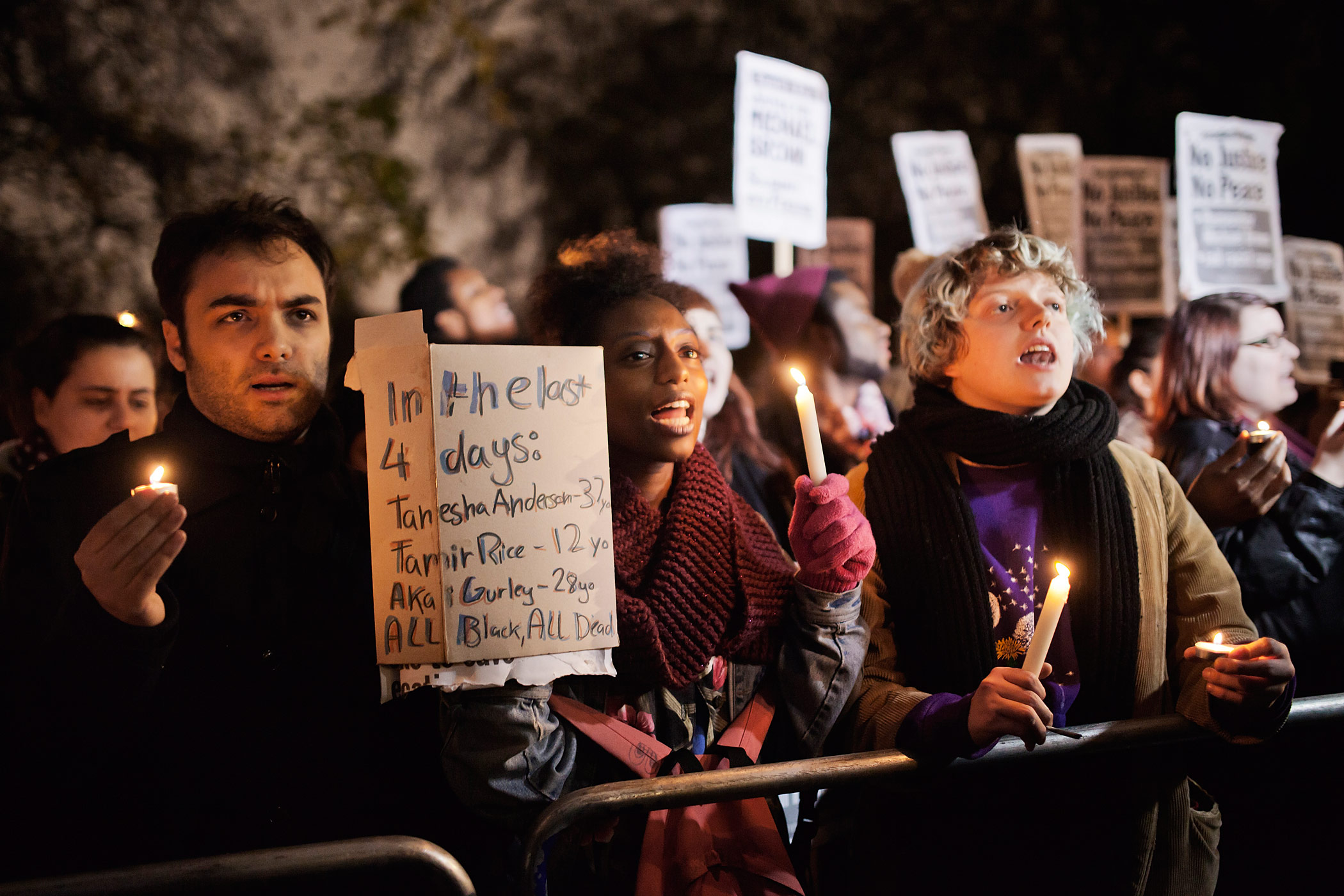 People gather outside the US embassy in Central London, supporting the protests in Ferguson on Nov. 26, 2014.