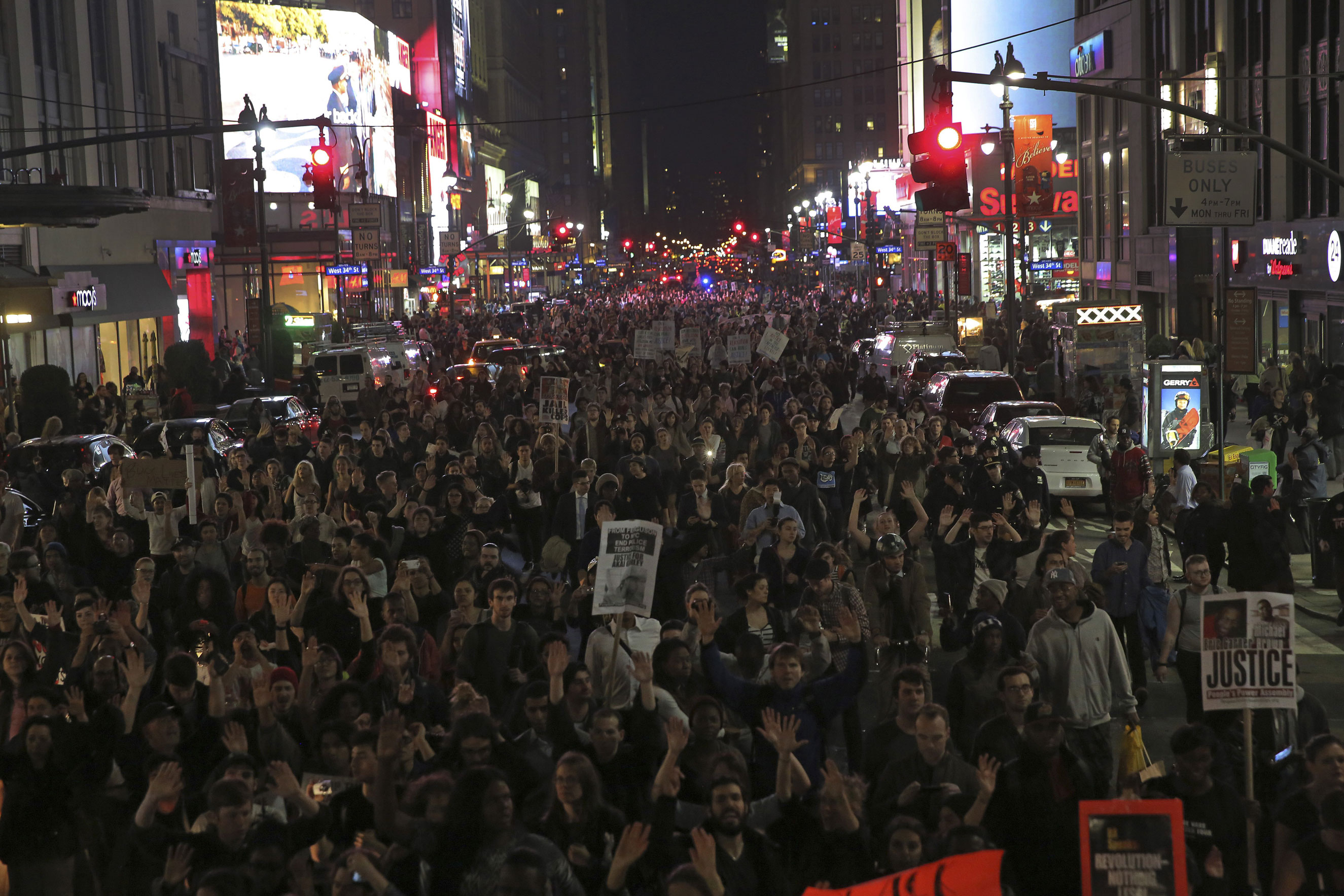 Protesters march near Times Square in New York City on Nov. 24, 2014.
