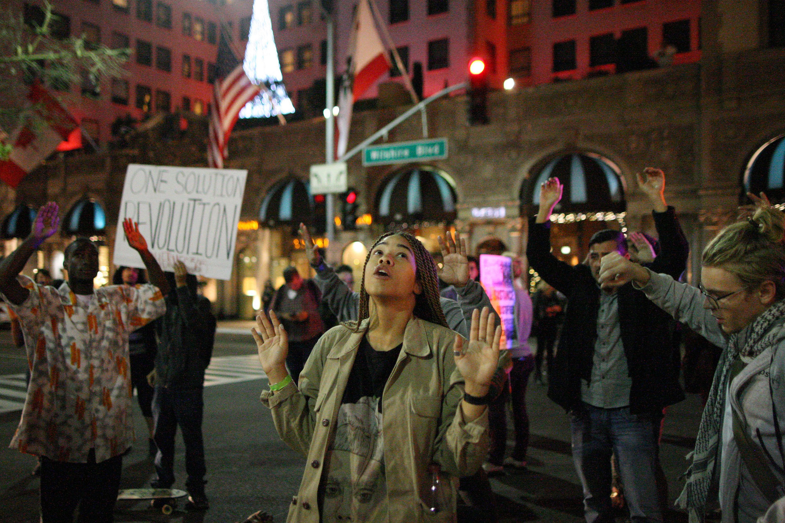 Protesters block the intersection of Wilshire Boulevard and Rodeo Dr. in Beverly Hills, Calif., on Nov. 24, 2014.