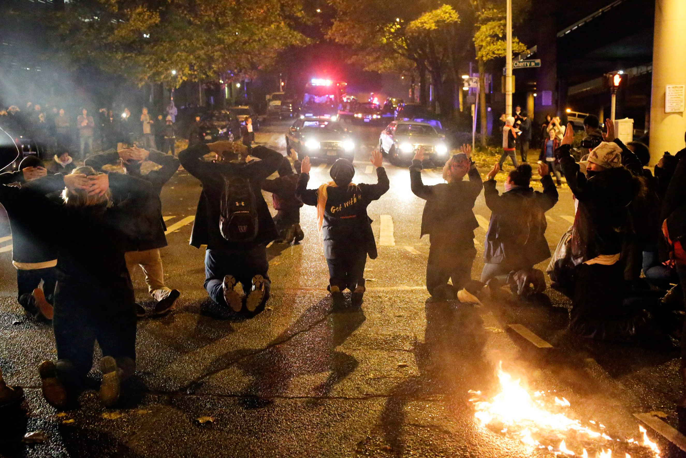 Protesters kneel during a demonstration in Seattle on Nov. 24, 2014.