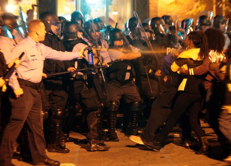 After warning protesters to disperse for unlawfully gathering, police dressed in riot gear pepper spray protesters in St. Louis on Oct. 8, 2014.