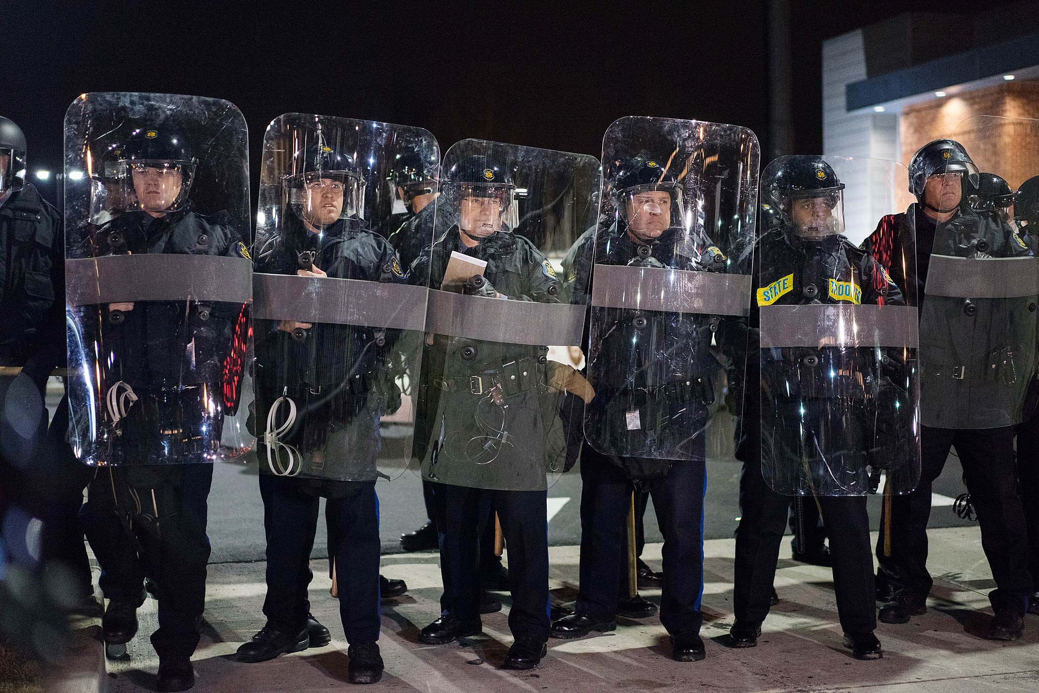 Police officers in riot gear stand guard in Ferguson, Mo. on Nov. 24, 2014