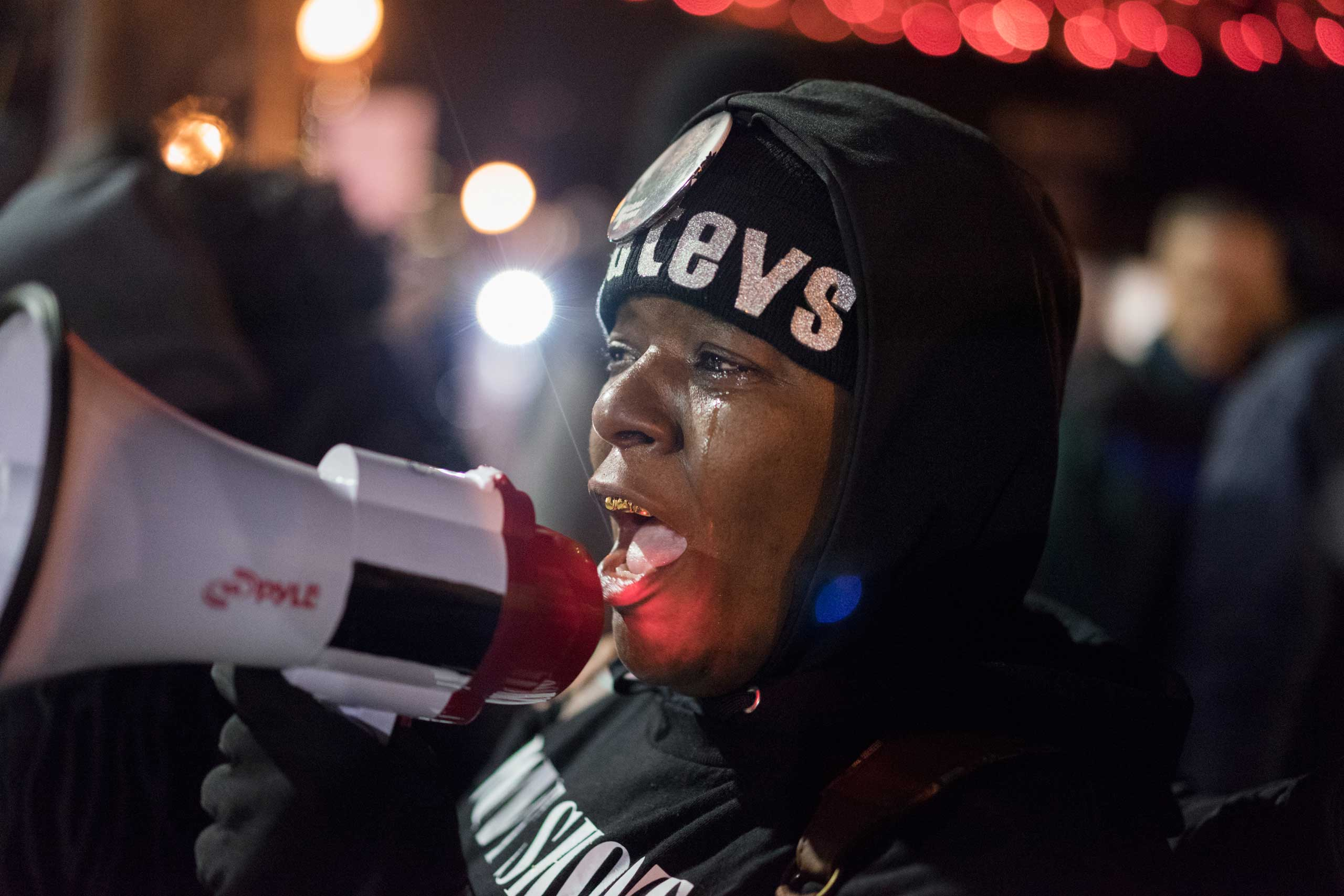 A woman speaks into a megaphone during protests in Ferguson, Mo. on Nov. 24, 2014
