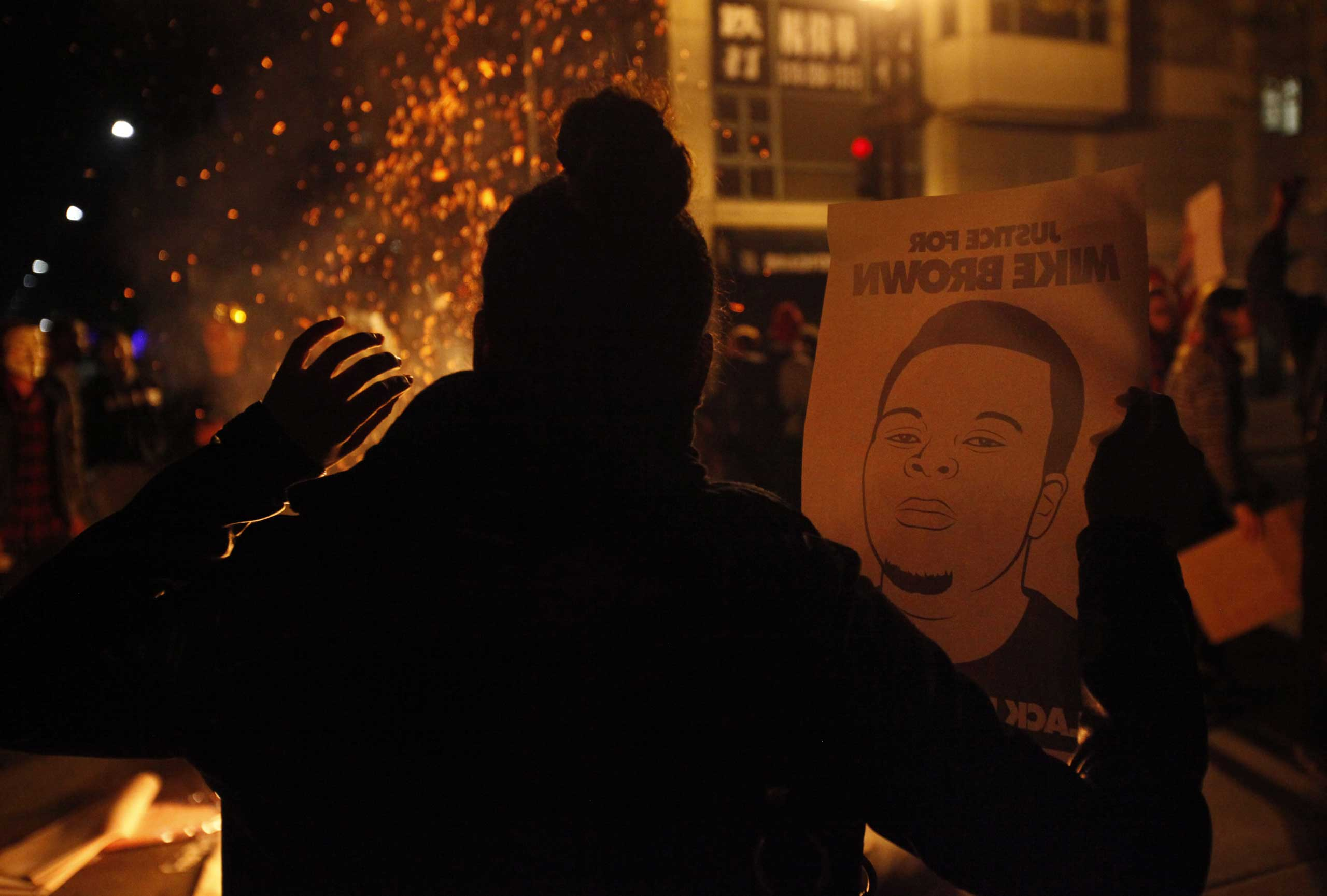 Protesters hold up their hands in protest in Oakland, Calif. on Nov. 25, 2014.