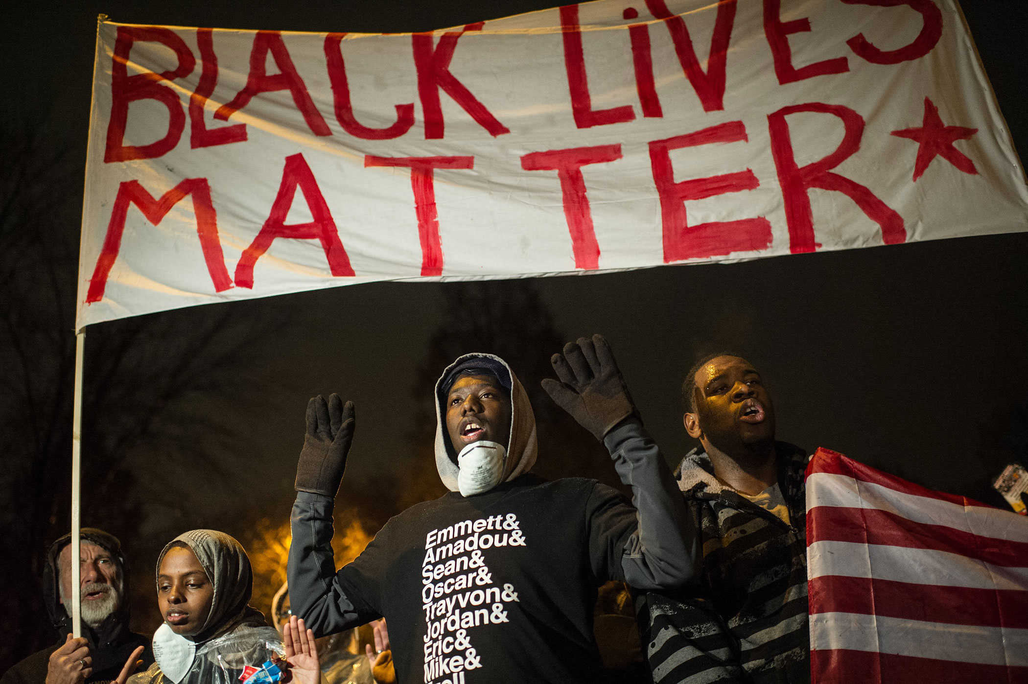 Protesters march shouting slogans through neighborhoods in St. Louis on Nov. 23, 2014