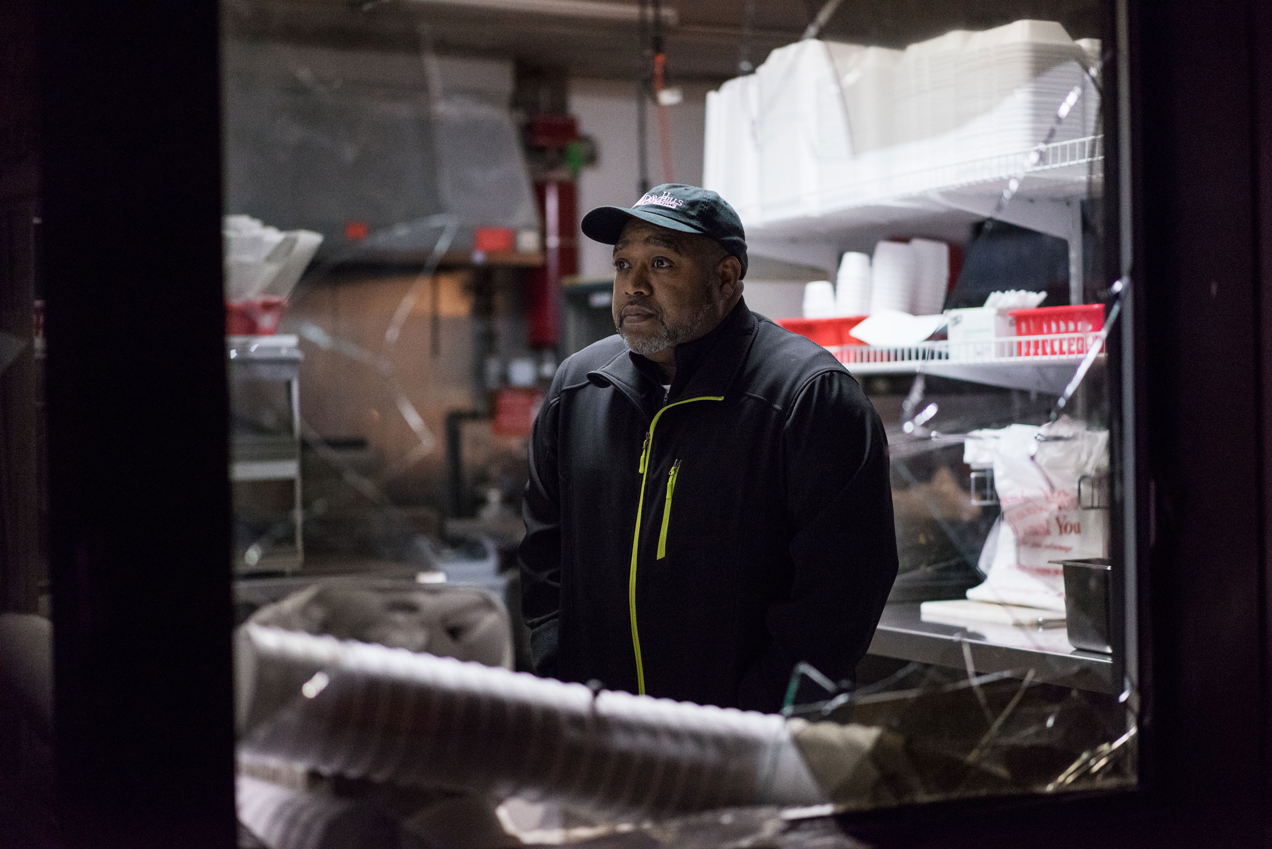 Patrick London surveys the damage at his fast food restaurant London's Wing House after it was looted during protests on Nov. 24, 2014.