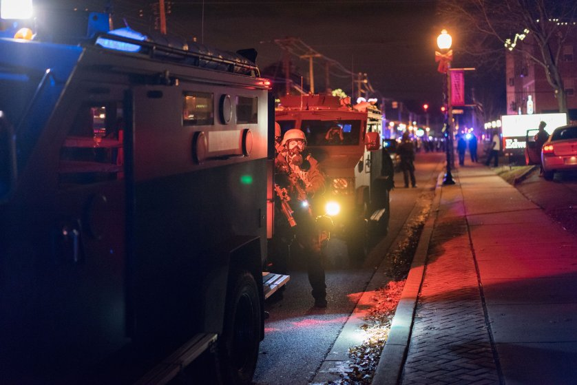 Law enforcement responds to protestors amidst tear gas and smoke in Ferguson, Mo. on Nov. 24, 2014