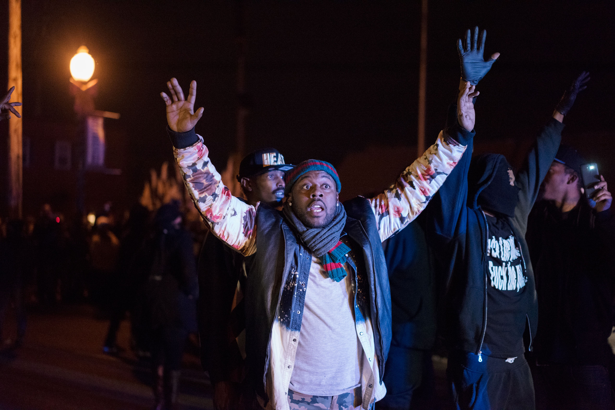 A demonstrator puts his hands in the air amid protests in Ferguson, Mo. on Nov. 24, 2014