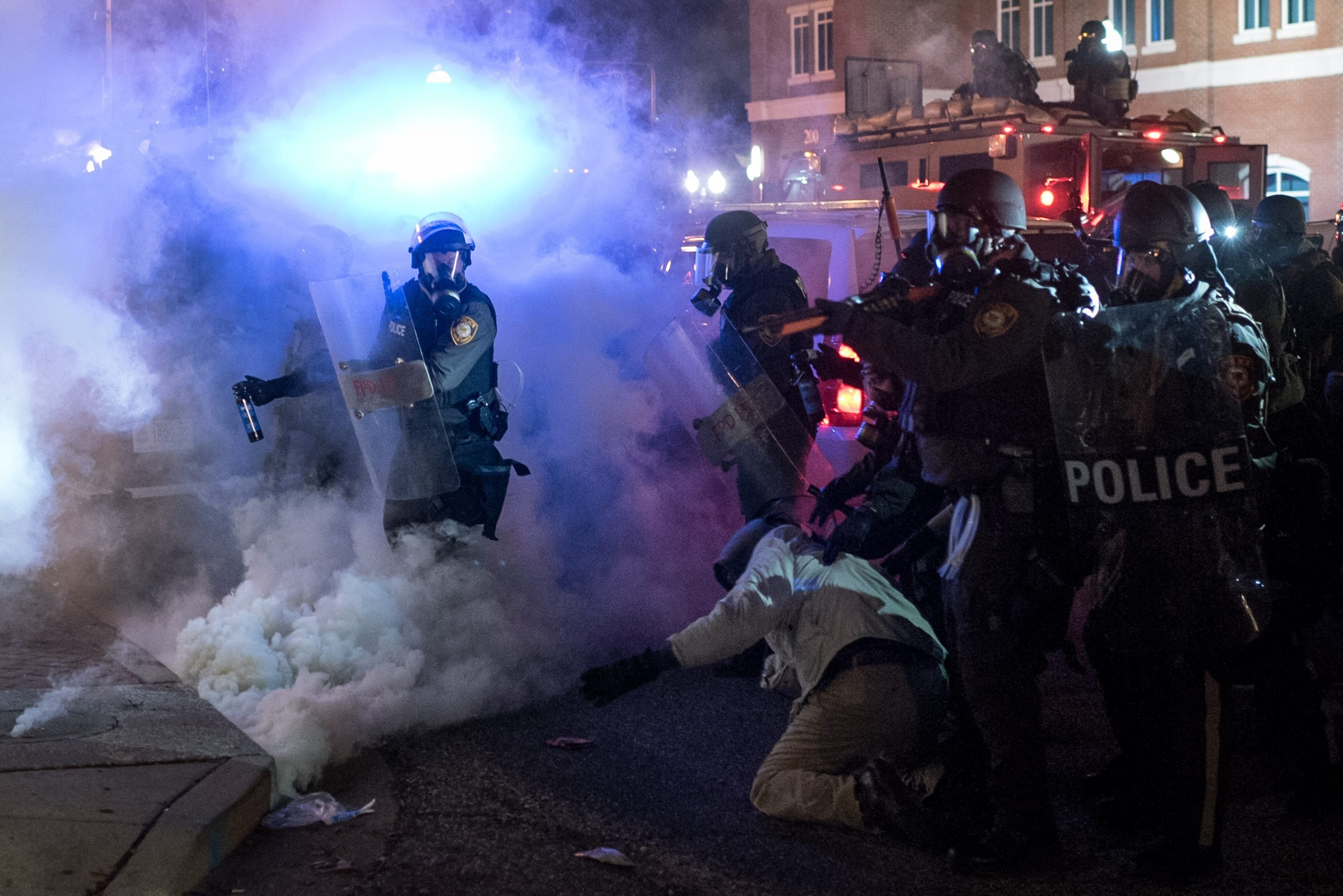 Riot policemen clash with protesters in Ferguson Mo. on Nov. 24, 2014.