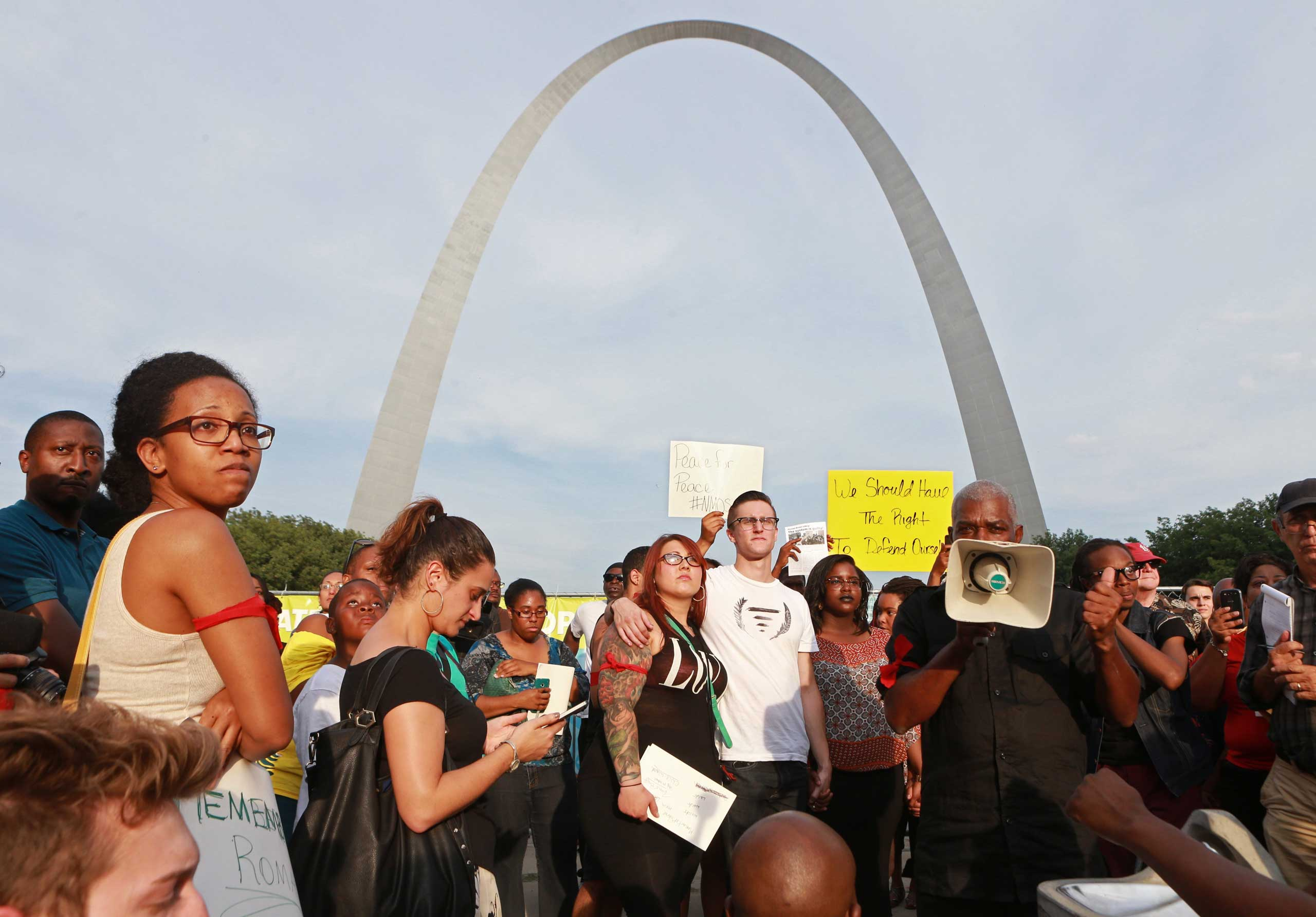 Aug. 14, 2014. A crowd of several hundred gatheres in a park near the Gateway Arch for a moment of silence on Thursday in St. Louis during a peace vigil and moment of silence for Michael Brown, an unarmed teenager who was shot and killed by Ferguson, Mo., police on Saturday.