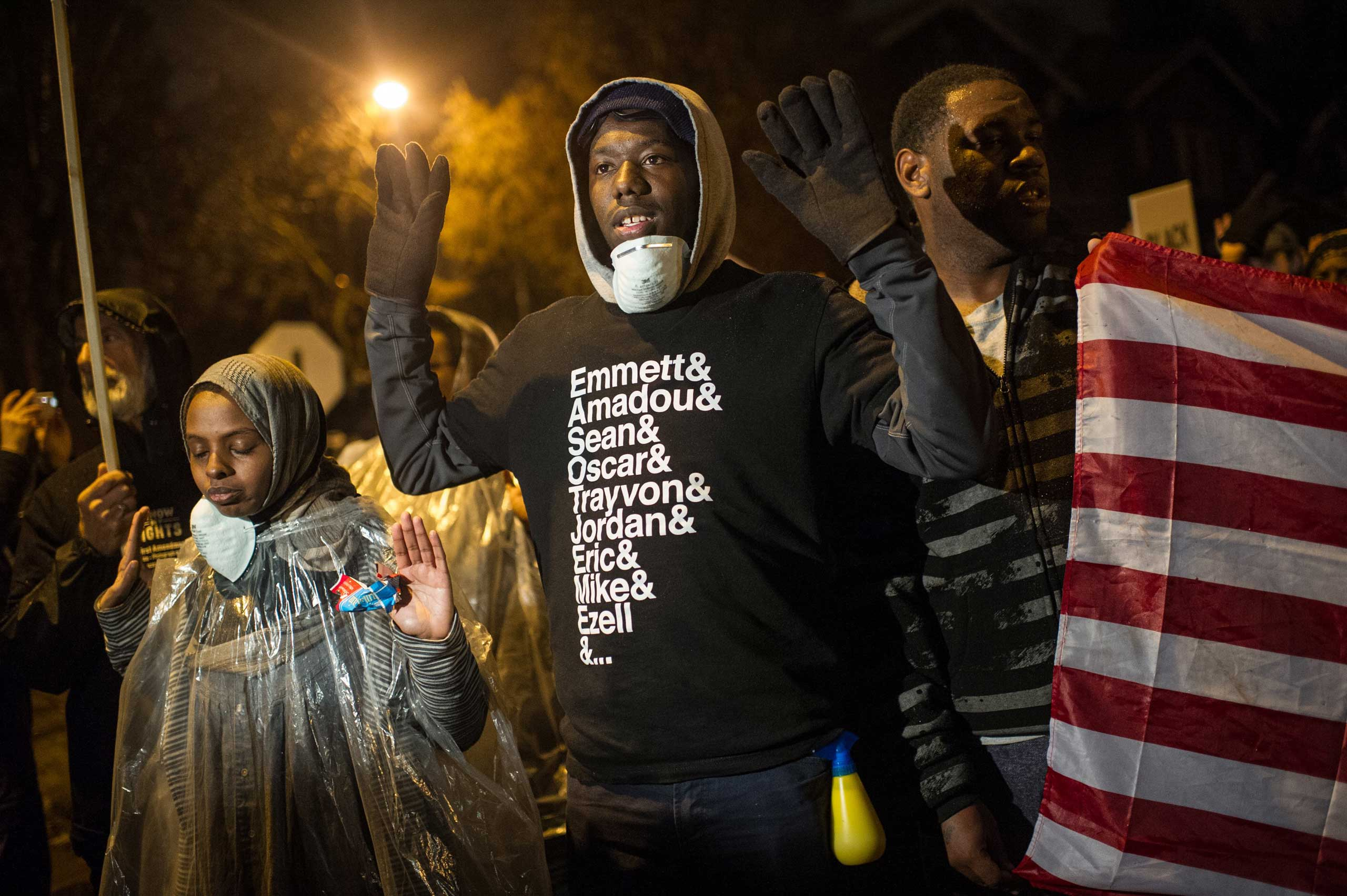 Protesters march through neighborhoods in St. Louis on Nov. 23, 2014