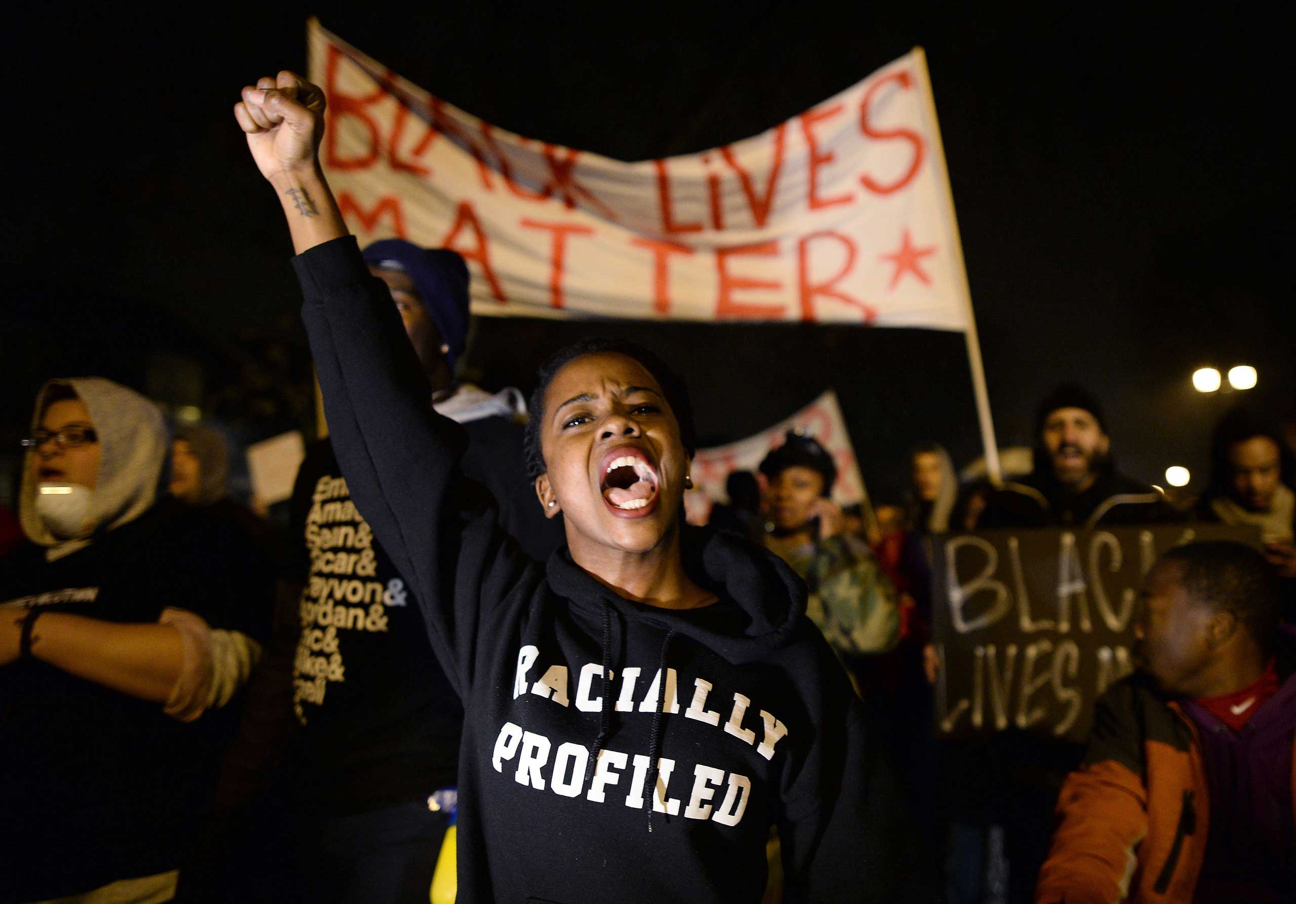 Demonstrators shout slogans during a march in St. Louis, on Nov. 23, 2014