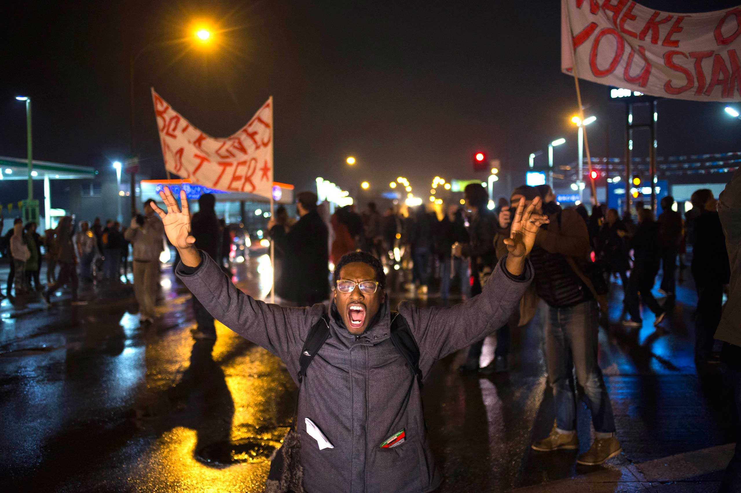 A protester, demanding the criminal indictment of Darren Wilson, shouts slogans while stopping traffic in St. Louis, on Nov. 23, 2014