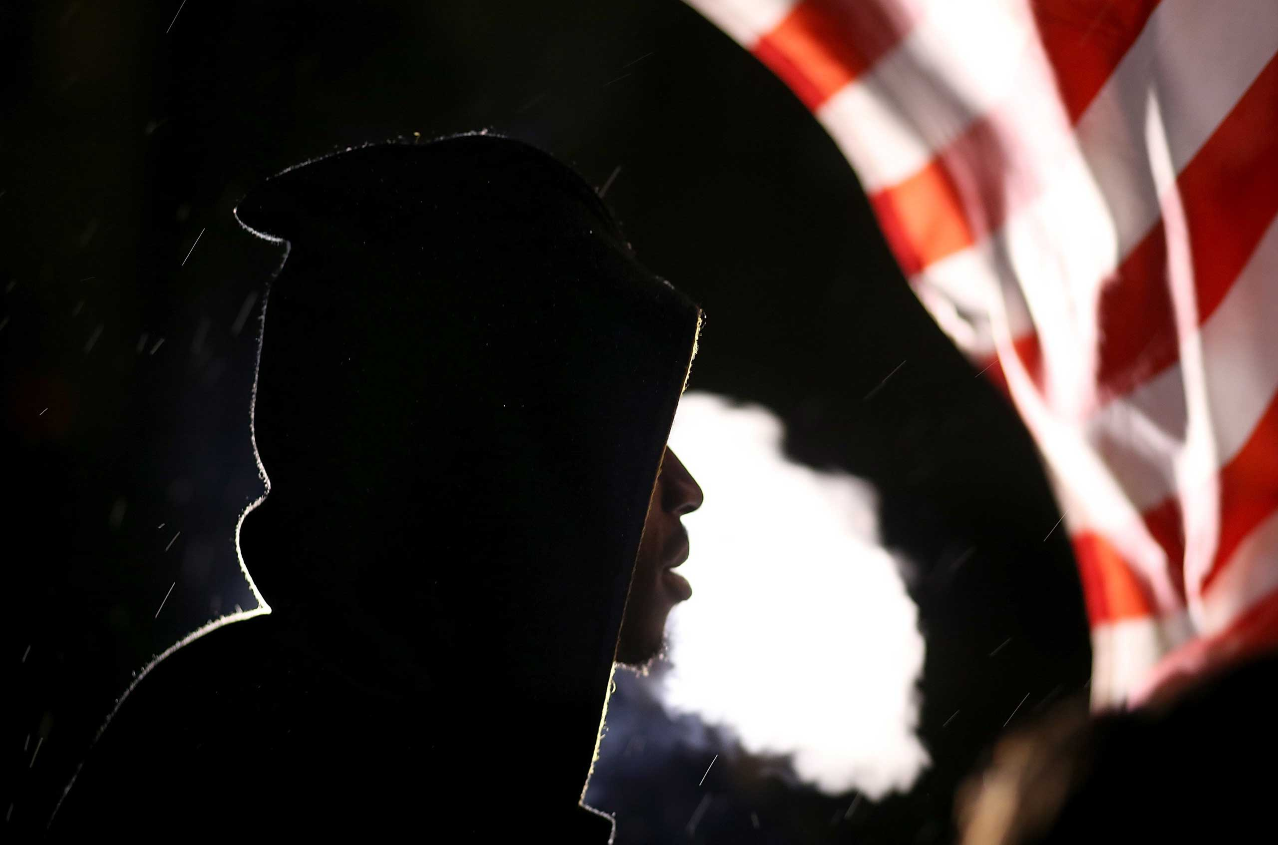 A demonstrator protesting the shooting death of Michael Brown blows cigar smoke in Ferguson, Mo. on Nov. 22, 2014