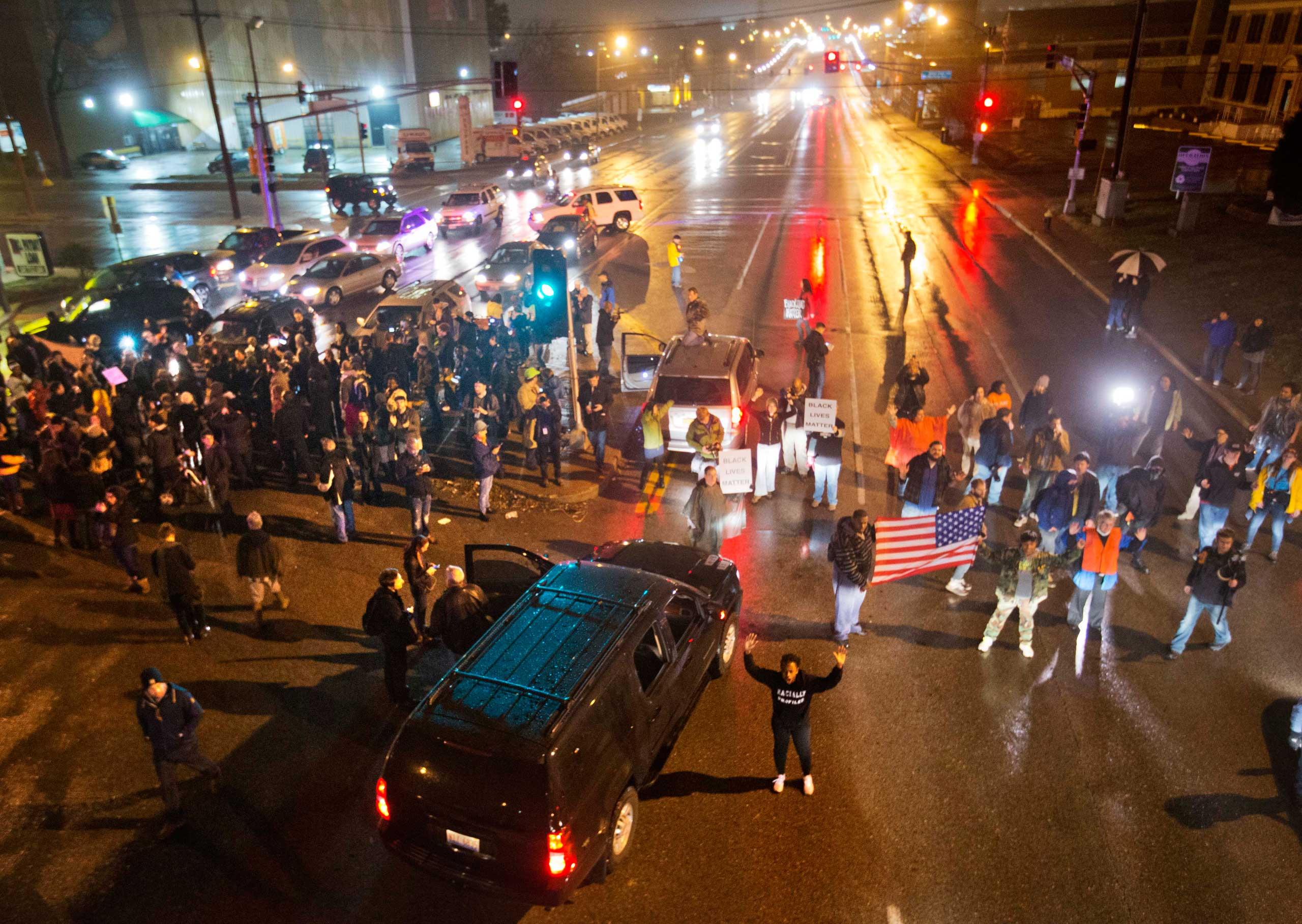 Demonstrators block a busy intersection while marching through the streets to protest the shooting of Michael Brown, in St. Louis on Nov. 23, 2014