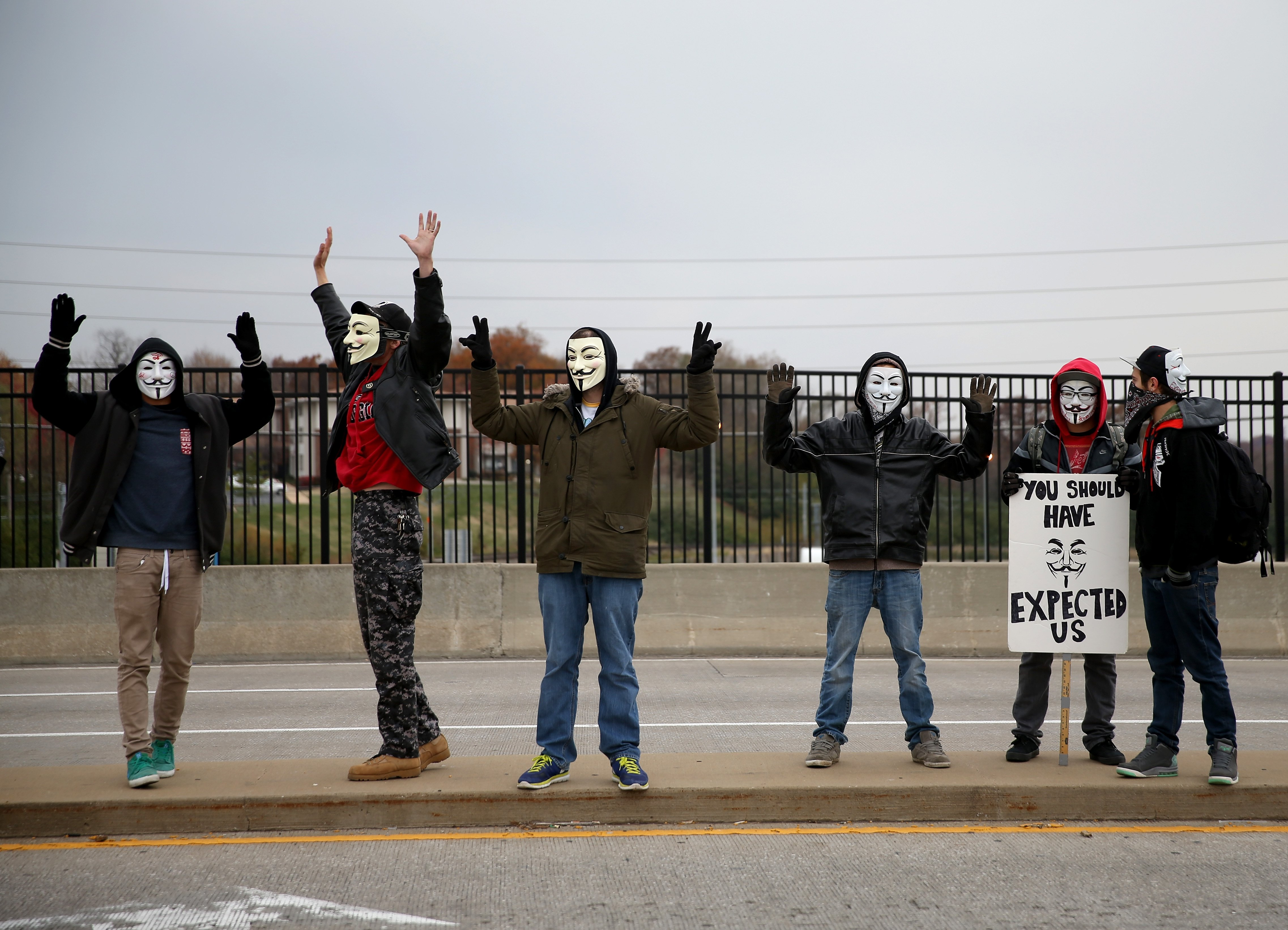 Demonstrators yell  Hands Up, Don't Shoot  alongside a highway overpass to voice their opinions as the area awaits a grand jury decision on Nov. 15, 2014 near Ferguson, Missouri.