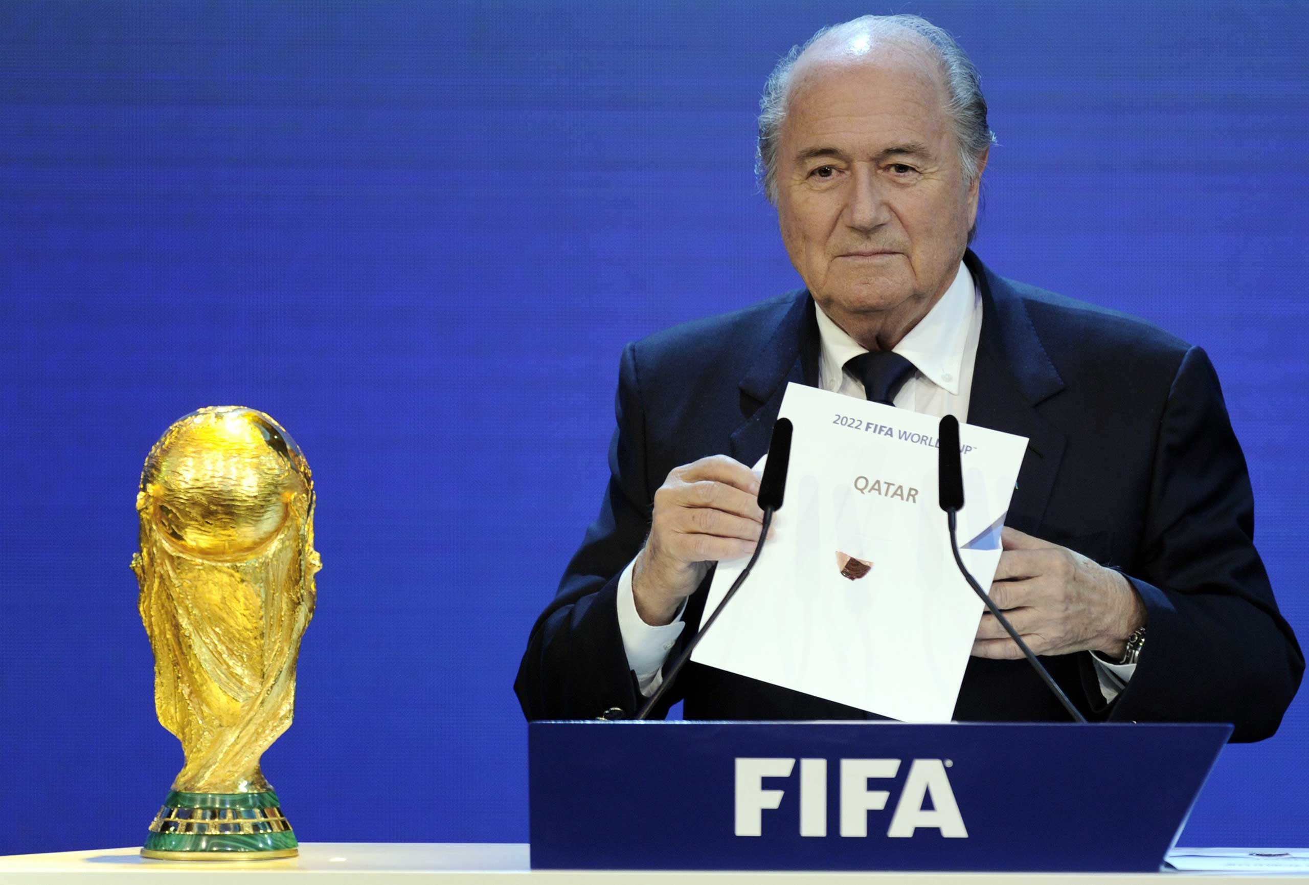 FIFA President Sepp Blatter holding up the name of Qatar during the official announcement of the 2022 World Cup host country at the FIFA headquarters  in Zurich, Dec. 2, 2010.