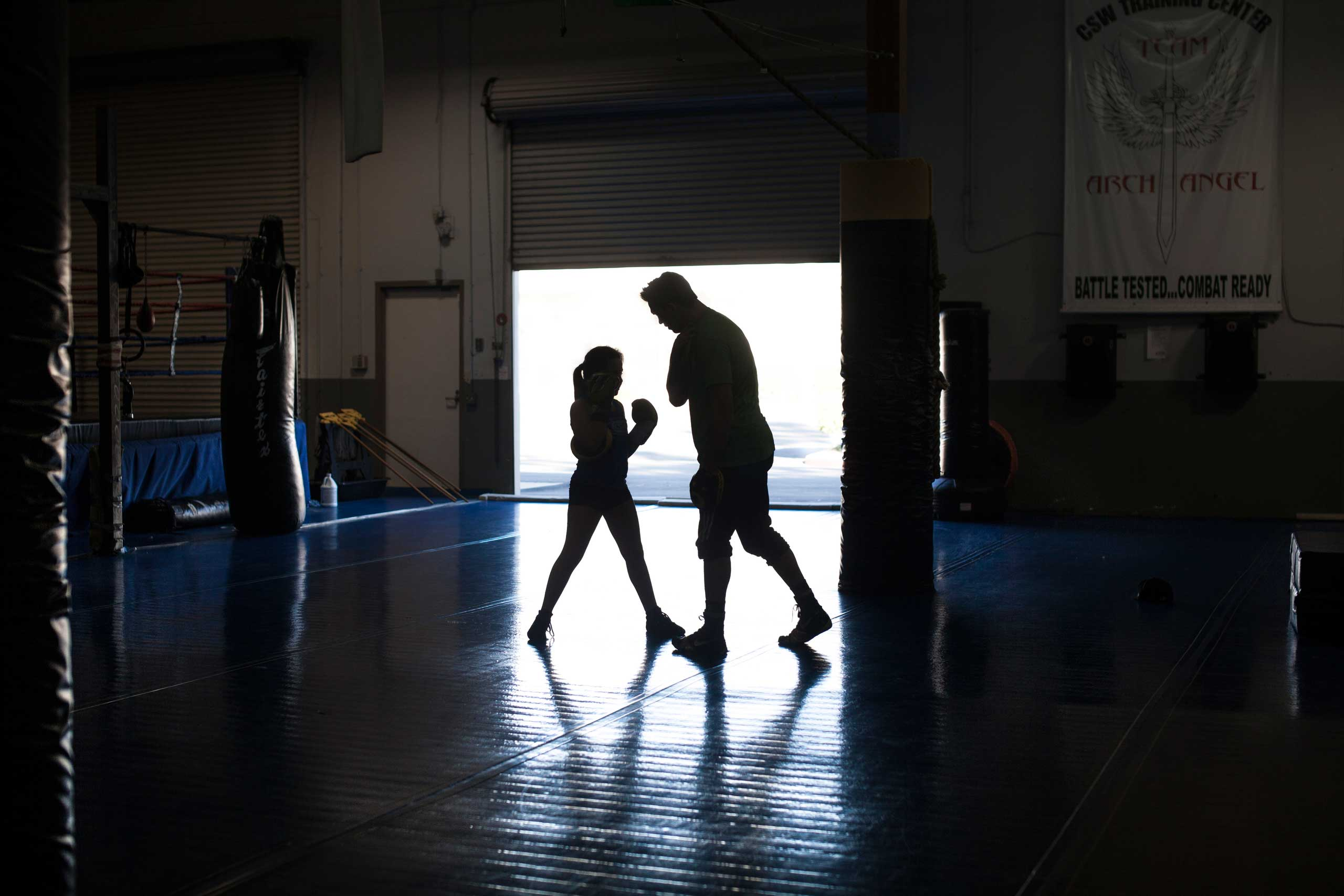 Cheyenne Bowman, 11, during personal mixed martial arts practice with coach Craig Wilkerson, a professional MMA fighter. La Habra, Calif., Nov. 2013.