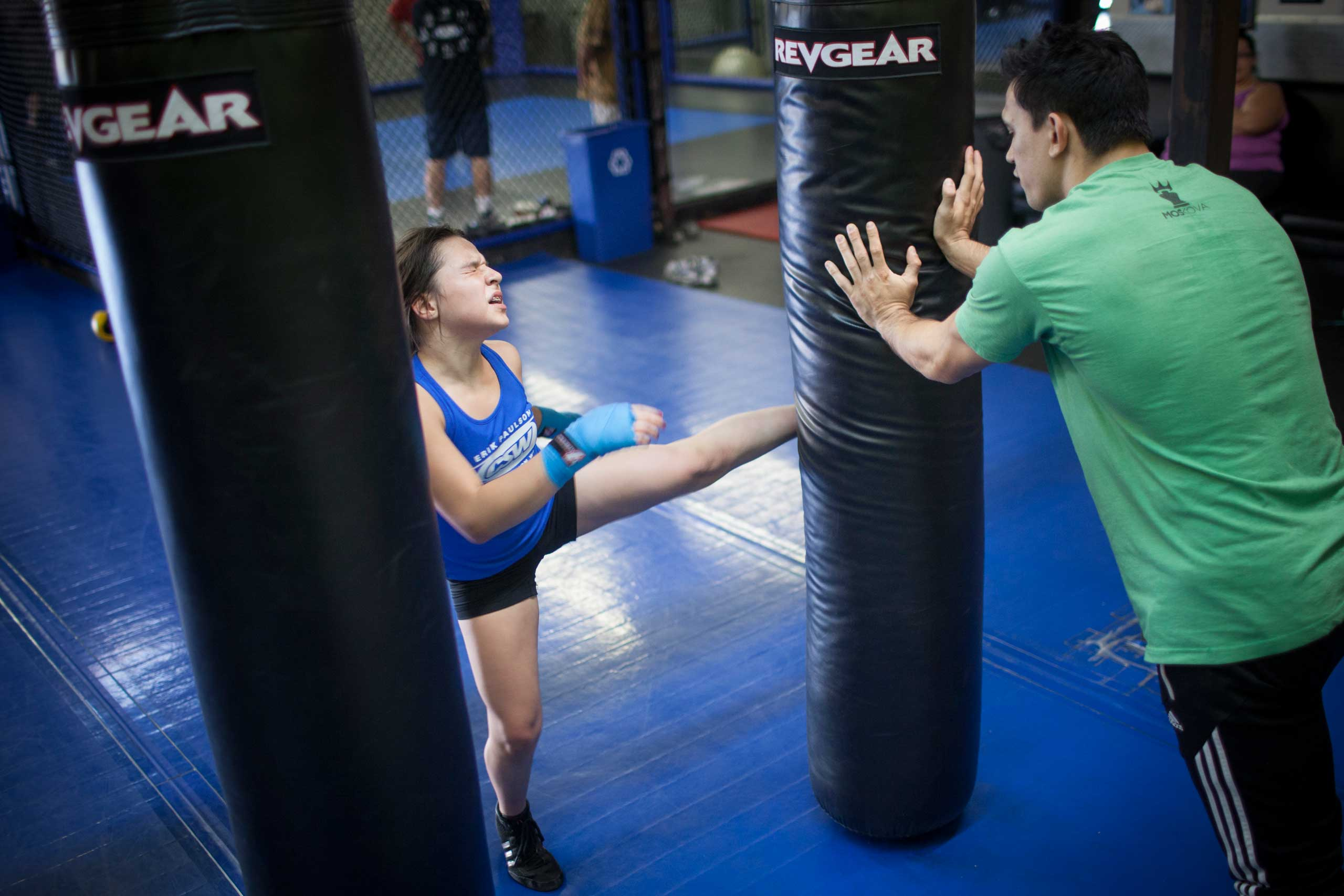Cheyenne Bowman, 11, at personal mixed martial arts practice with coach Craig Wilkerson, a professional MMA fighter. La Habra, Calif., Nov. 2013.