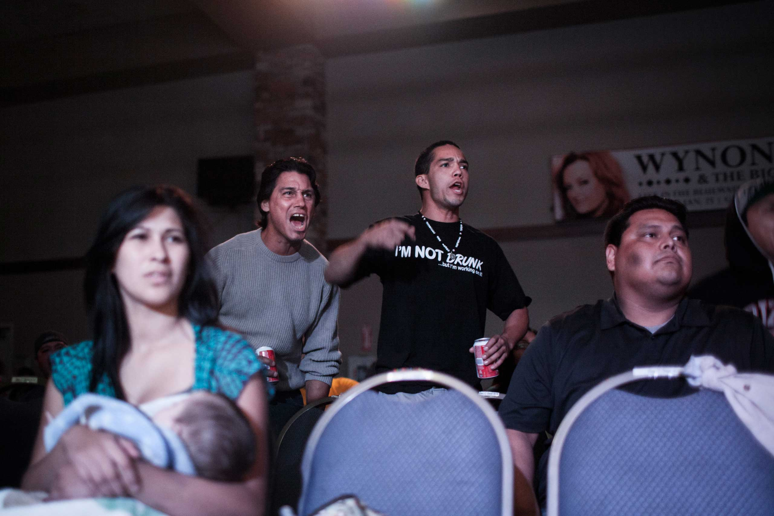 Crowd cheering young mixed martial arts fighters at United States Fight League All-star Pankration show at Blue Water Casino in Parker, Arizona, Oct. 2013.
