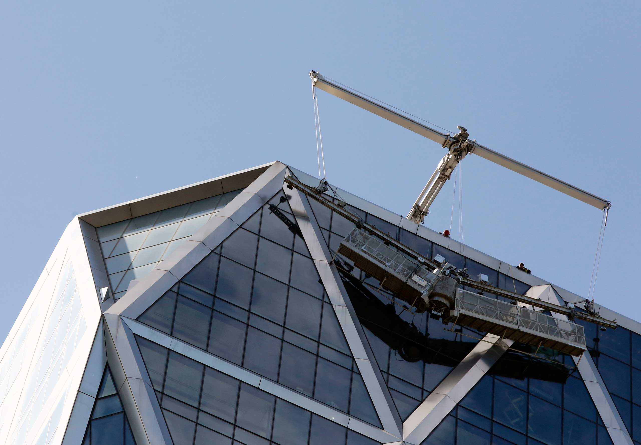 Rescuers help window washers trapped on the Hearst Tower in New York in 2013.