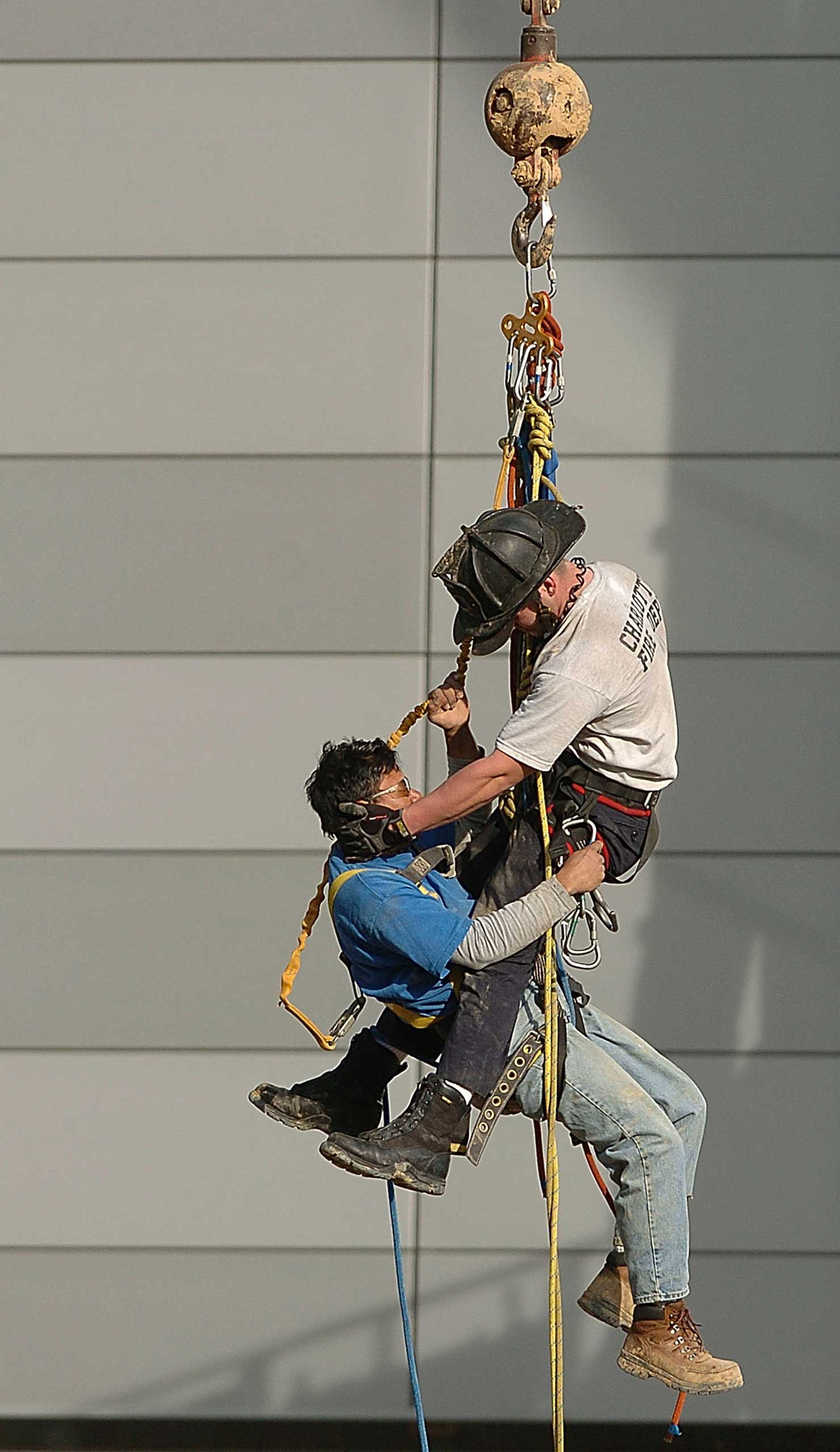 Firefighter Billy Mitchell rescues an injured construction worker in Charlotte, N.C., in 2005.
