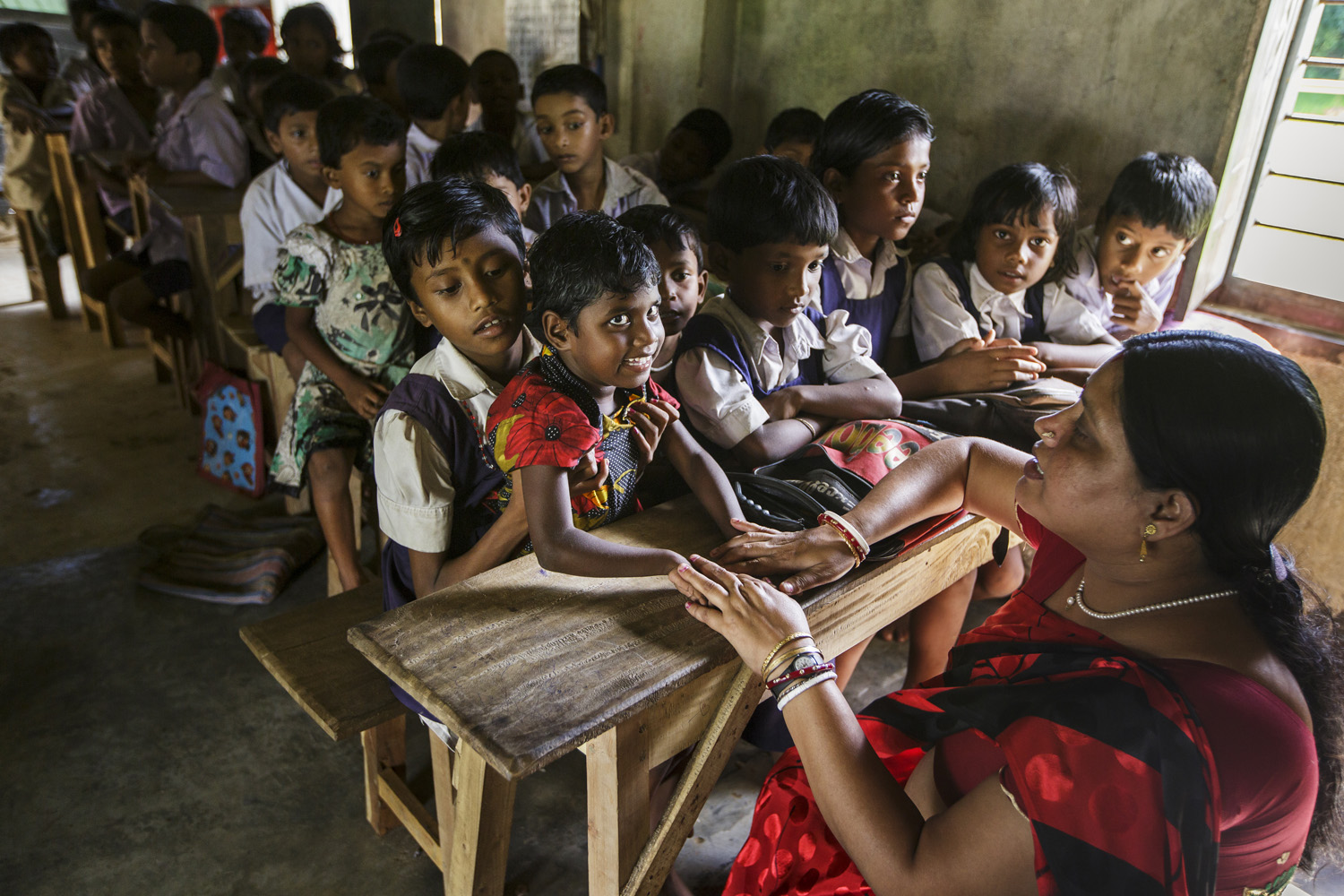 Anita Singh participates in lessons at her rural Indian school, Oct. 20, 2013 in West Bengal, India.
