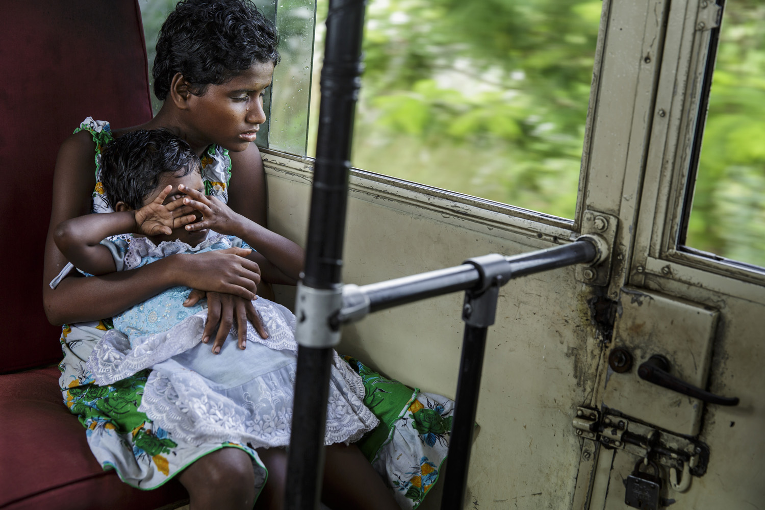 Sonia and Anita Singh are seen on a bus on their way to donor sponsored cataract surgery, Oct. 21, 2013 in West Bengal, India.
