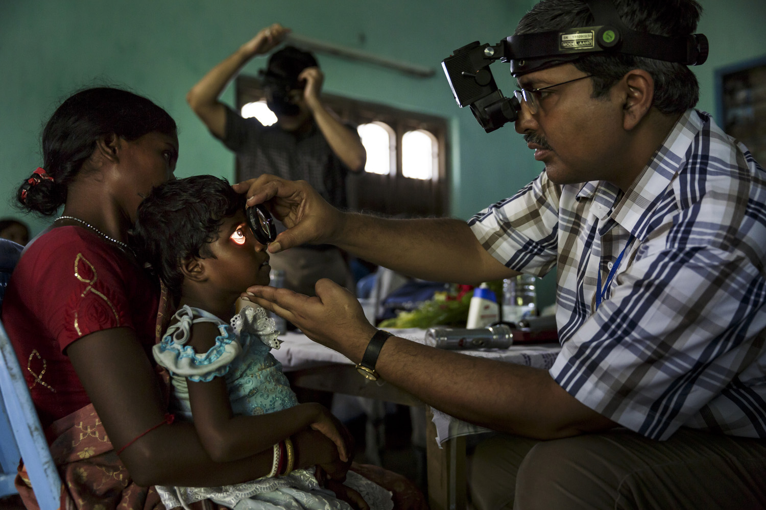Anita Singh has her eyes examined by Dr Asim Sil at a donor sponsored blind camp to determine which kind of surgery she should undergo, Oct. 21, 2013 in West Bengal, India.