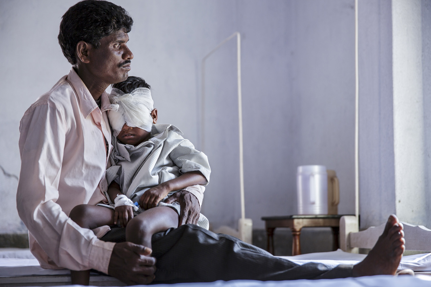 Anita Singh is held by her father as she recovers from eye surgery at Vivekananda Mission Hospital, Oct. 23, 2013 in West Bengal, India.