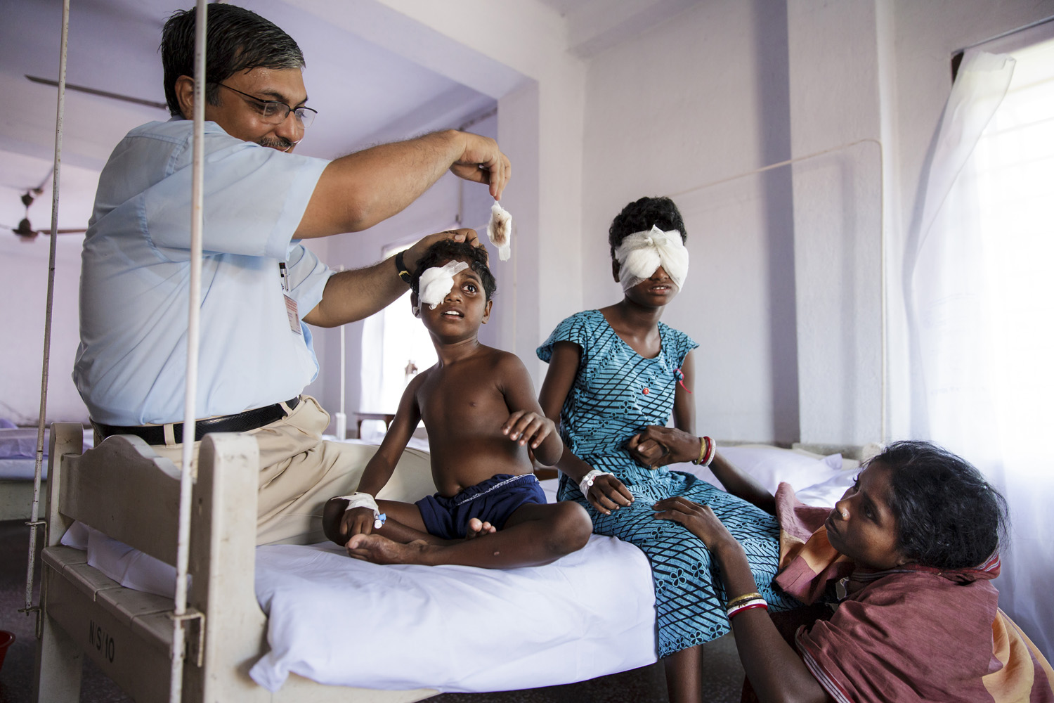 Anita Singh has bandages taken off her eyes by surgeon Dr Asim Sil at Vivekananda Mission Hospital, Oct. 23, 2013 in West Bengal, India.
