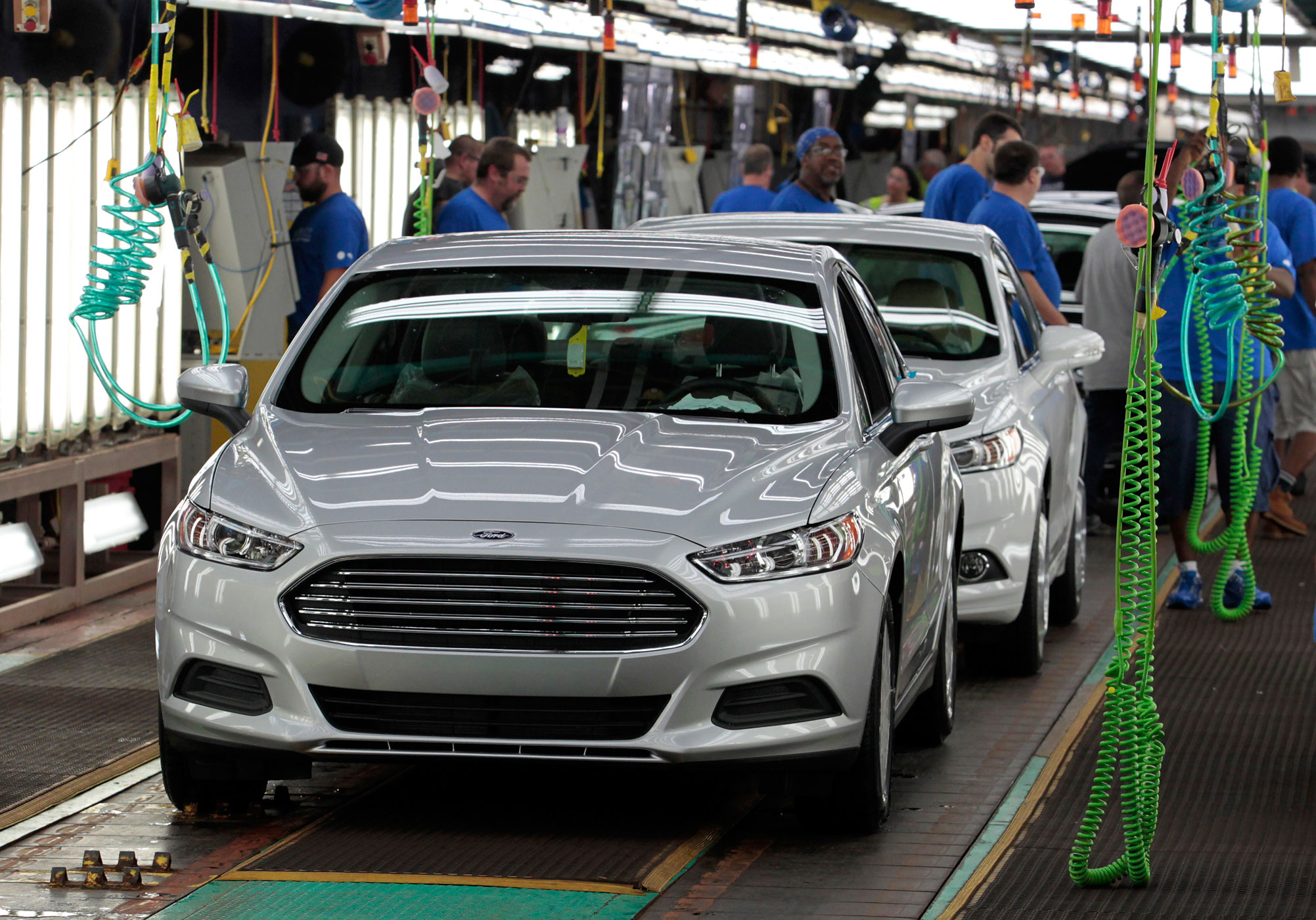 2014 Ford Fusion vehicles move down the production he line at the Flat Rock Assembly Plant in Flat Rock, Michigan, U.S., on Thursday, Aug. 29, 2013.