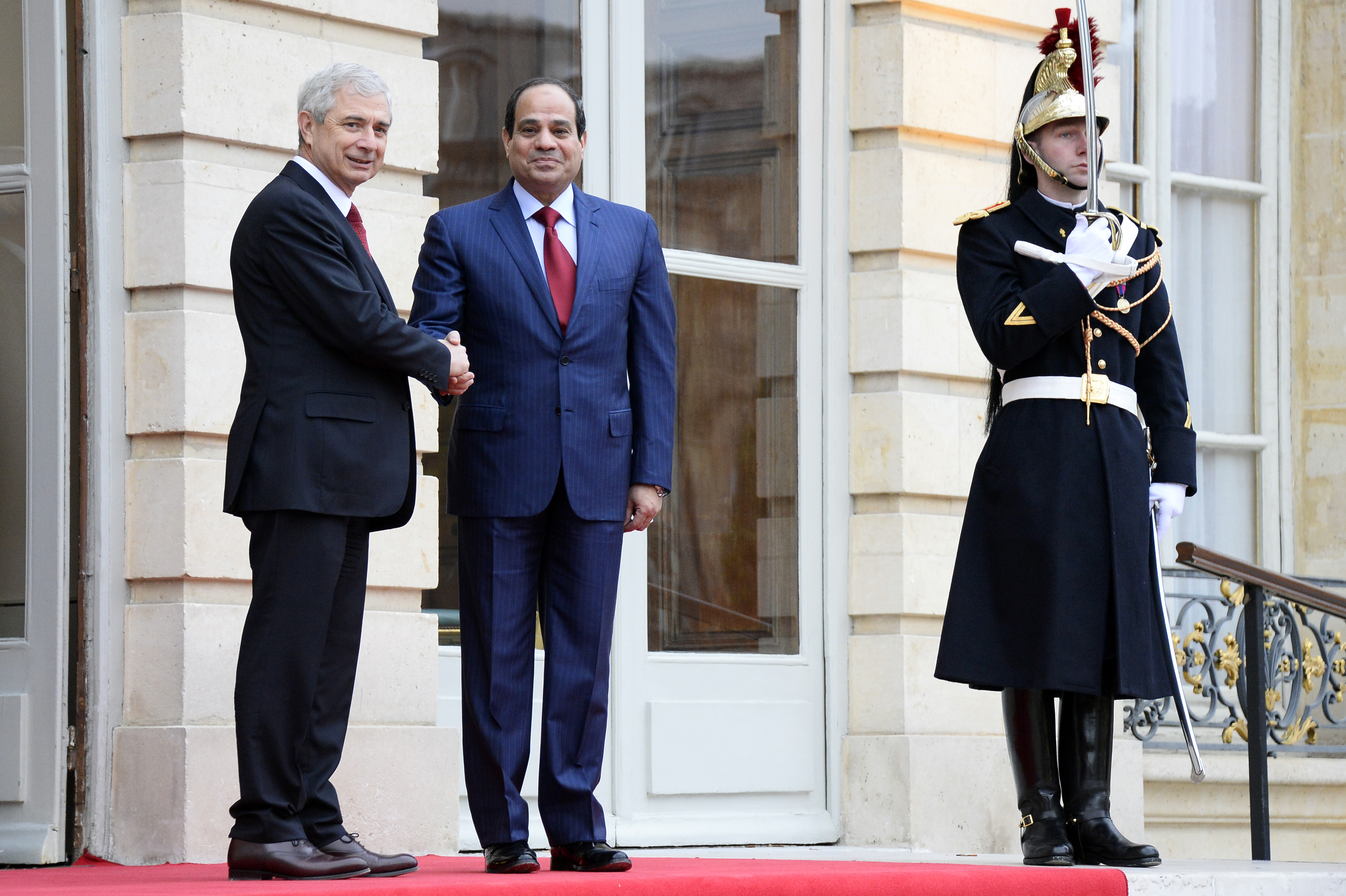 French National Assembly President Claude Bartolone, left, welcomes Egyptian President Abdul Fattah al-Sisi before their talks in Paris on Nov. 27, 2014