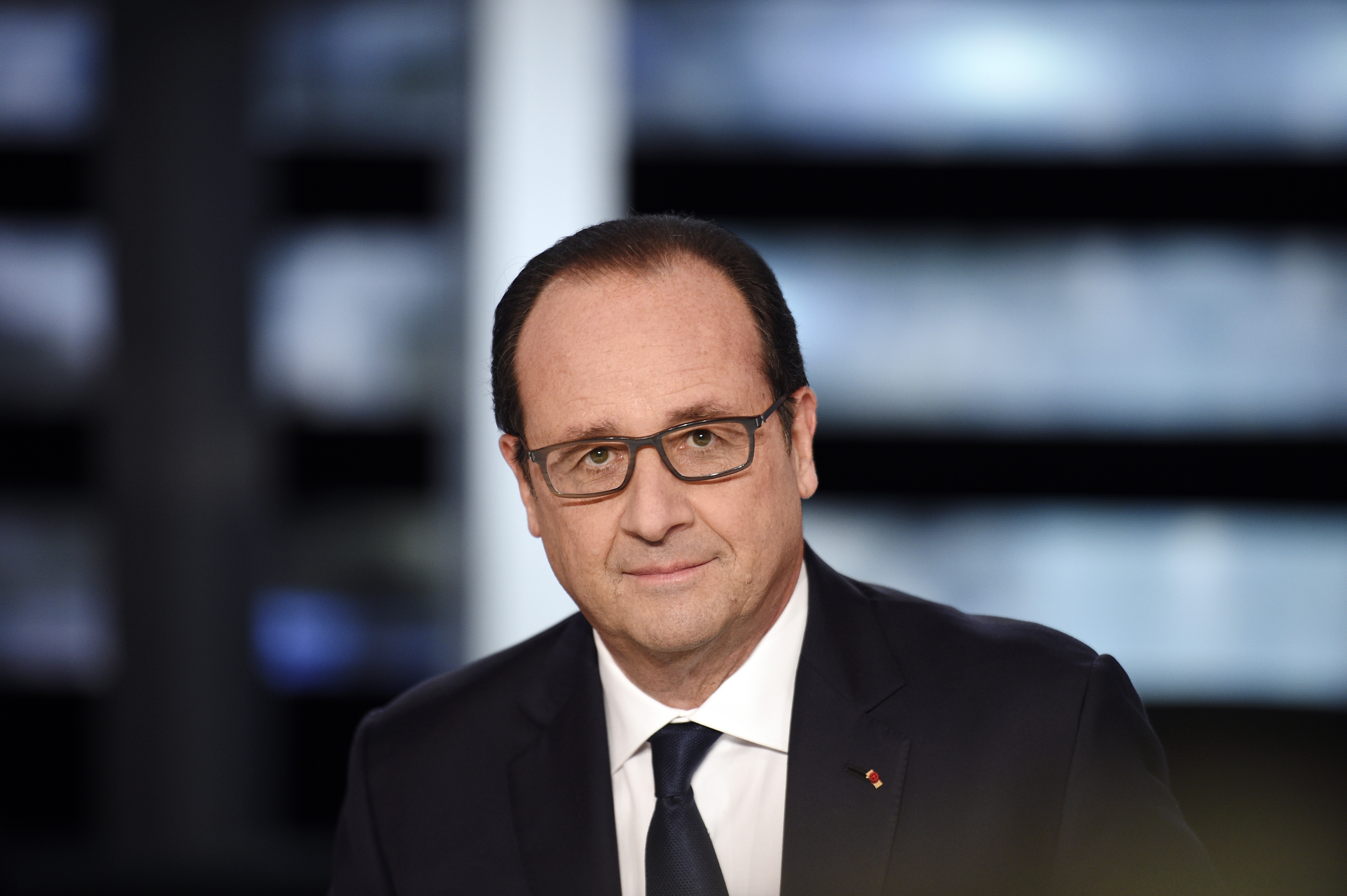 French President François Hollande poses on a TV set prior to the start of a French channel TF1 broadcast show, in Aubervilliers, outside Paris, on Nov. 6, 2014