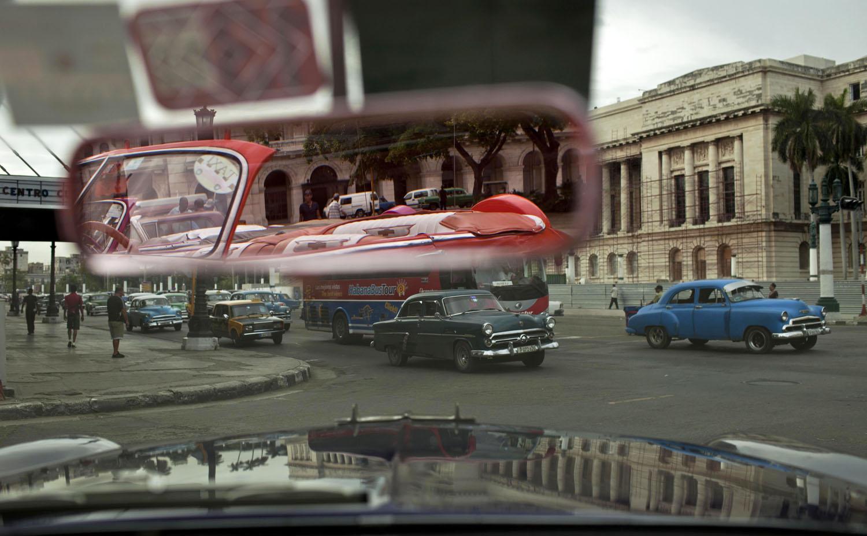 AP Photojournalist Franklin Reyes Marrero, 39,  Dies in HavanaPeople drive classic American car in Old Havana, Cuba, Oct. 16, 2014.