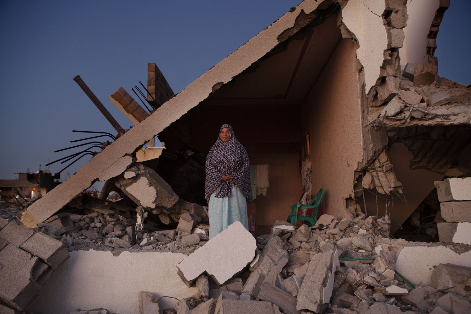 MSNBC: In Gaza, Life Persists Amid the RubbleSobheya Hamid Abu Mutlag, 59, poses at her home in Khan Yunis destroyed during the summer conflict between Israel and Hamas. Despite the serious damage, she cannot leave, since there is no place else for her to move, or it is too expensive to rent after the war. Khoza'a in Khan Yunis, Gaza. Oct. 5, 2014.