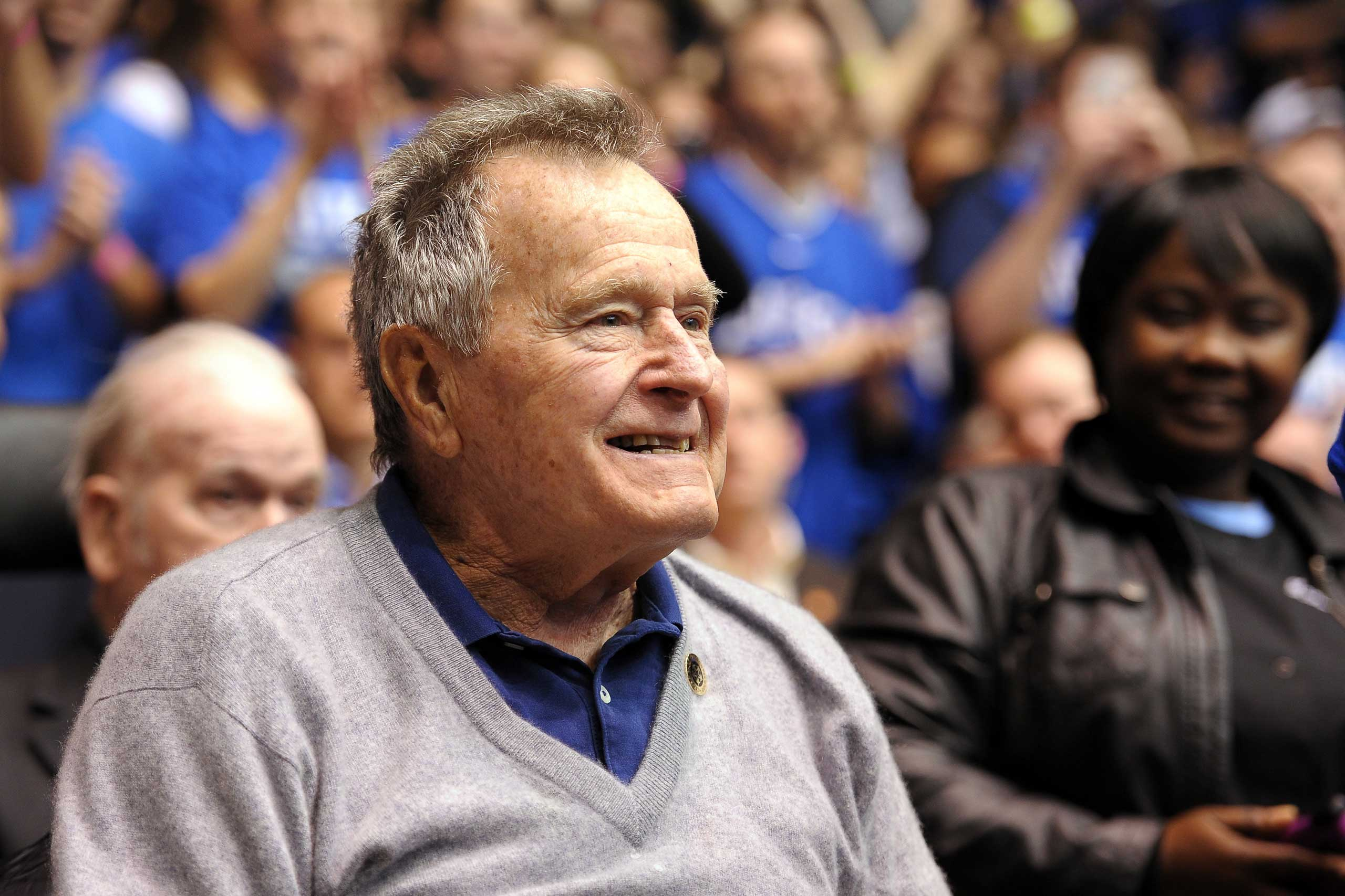 Former U.S. President George H.W. Bush looks on during a game between the North Carolina State Wolfpack and the Duke Blue Devils at Cameron Indoor Stadium in Durham, N.C., on Jan. 18, 2014