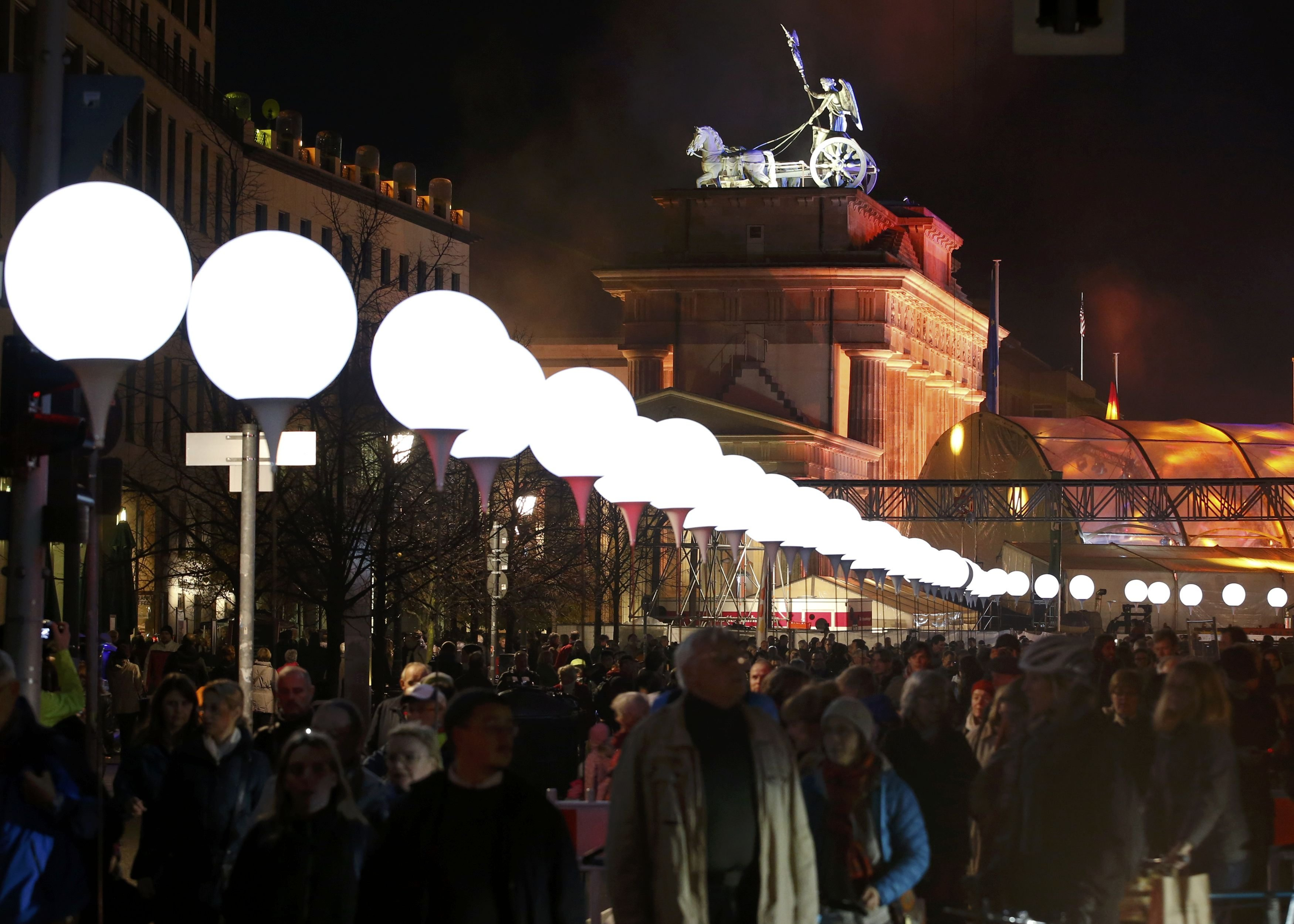 Lit balloons are placed along the former Berlin Wall location near the Brandenburg Gate in Berlin on Nov. 8, 2014.