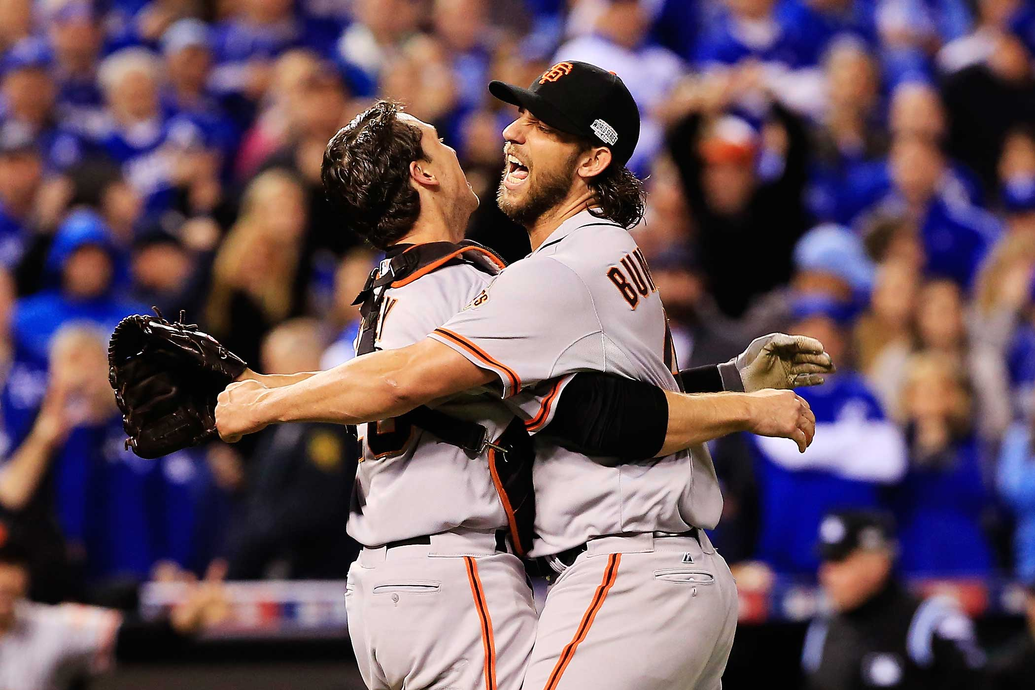 Buster Posey and Madison Bumgarner of the San Francisco Giants celebrate after defeating the Kansas City Royals to win Game Seven of the 2014 World Series by a score of 3-2 at Kauffman Stadium on October 29, 2014 in Kansas City, Missouri.