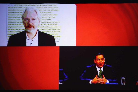Julian Assange and Glenn Greenwald discuss the revelations about New Zealand's mass surveillance at Auckland Town Hall in Auckland, New Zealand on Sept. 15, 2014.