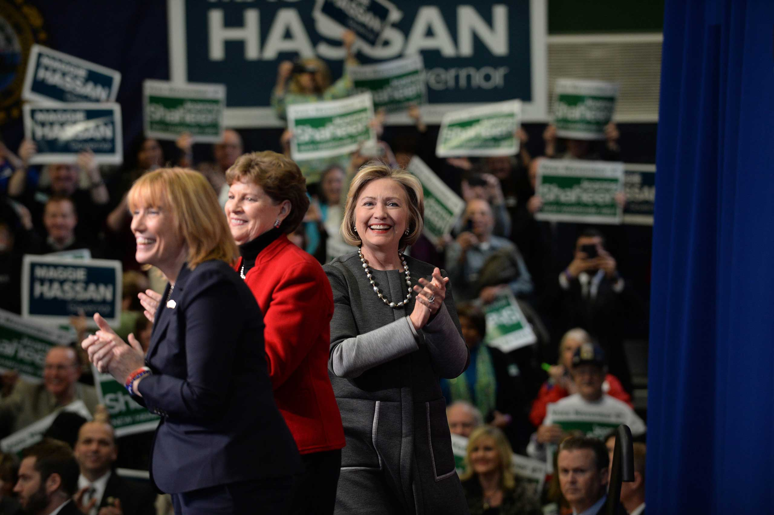 Former U.S. Secretary of State Hillary Clinton (R) campaigns with U.S. Senator Jeanne Shaheen (D-NH) and New Hampshire Governor Maggie Hassan (L) at Nashua Community College in Nashua, N.H. on Nov. 2, 2014.
