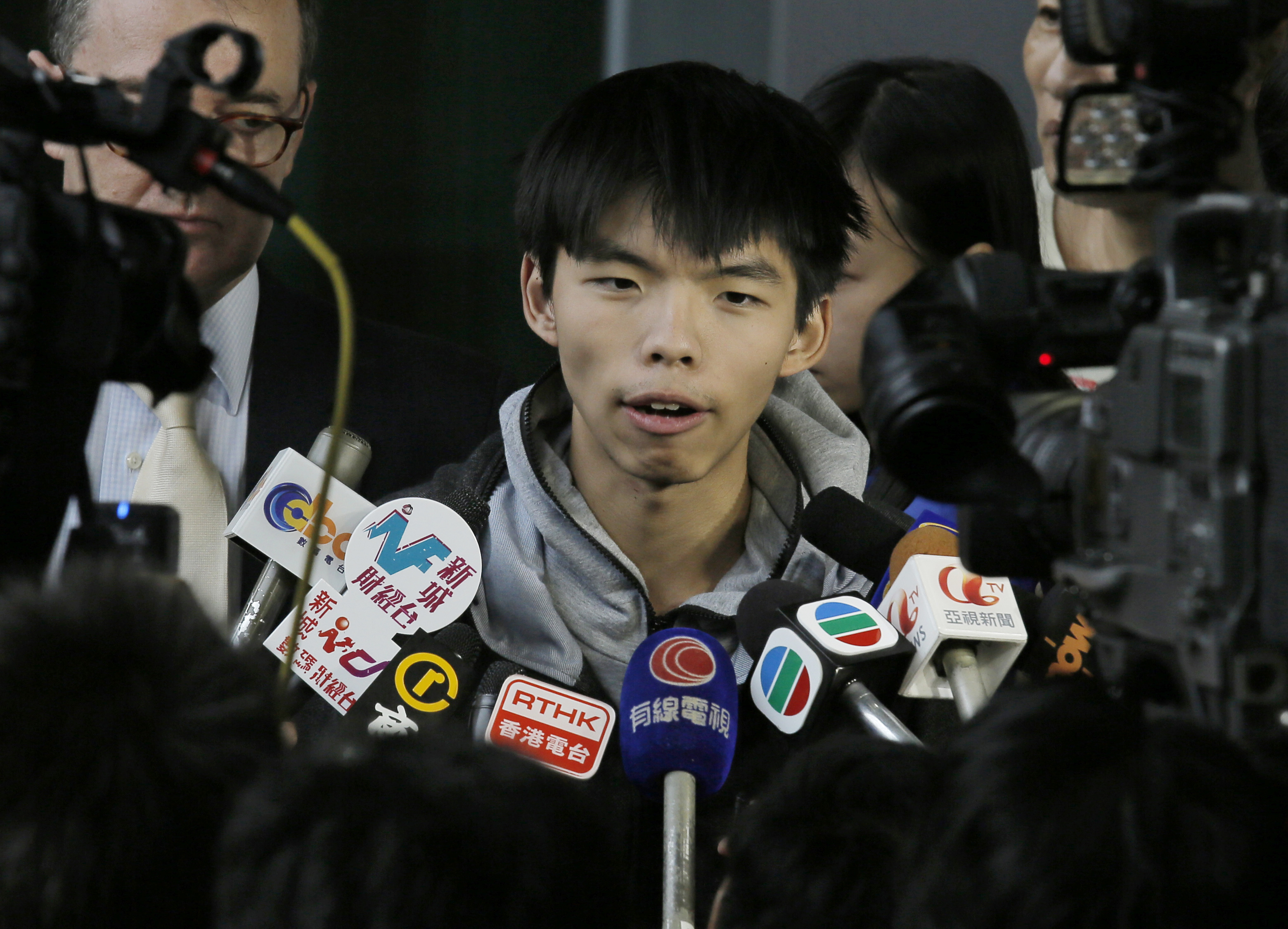 Prominent Hong Kong student protest leader Joshua Wong talks to reporters outside a court in Hong Kong on Nov. 27, 2014