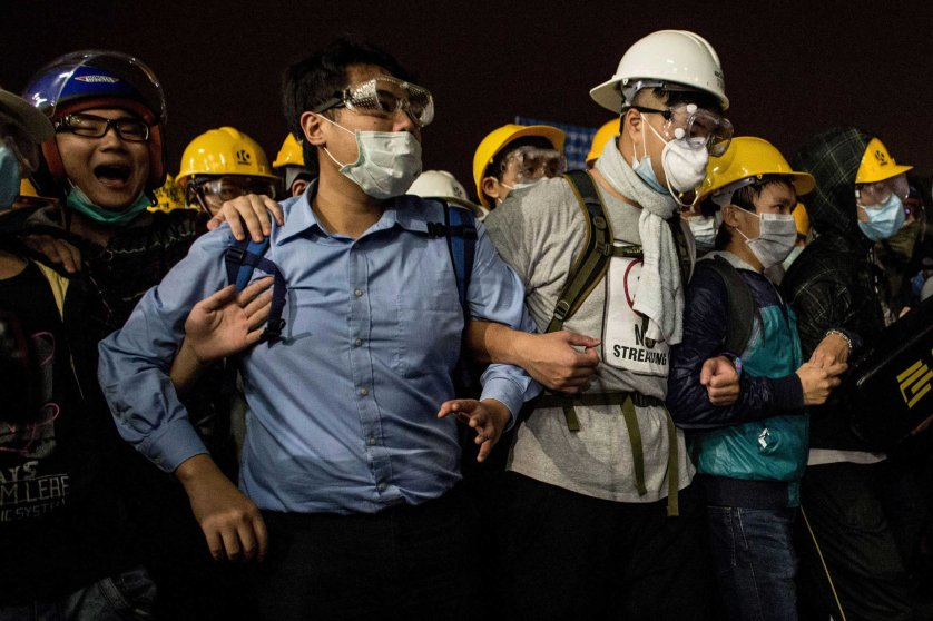 Pro-democracy activists join arms as they face off with police outside the Legislative Council building on Nov. 19, 2014 in Hong Kong.
