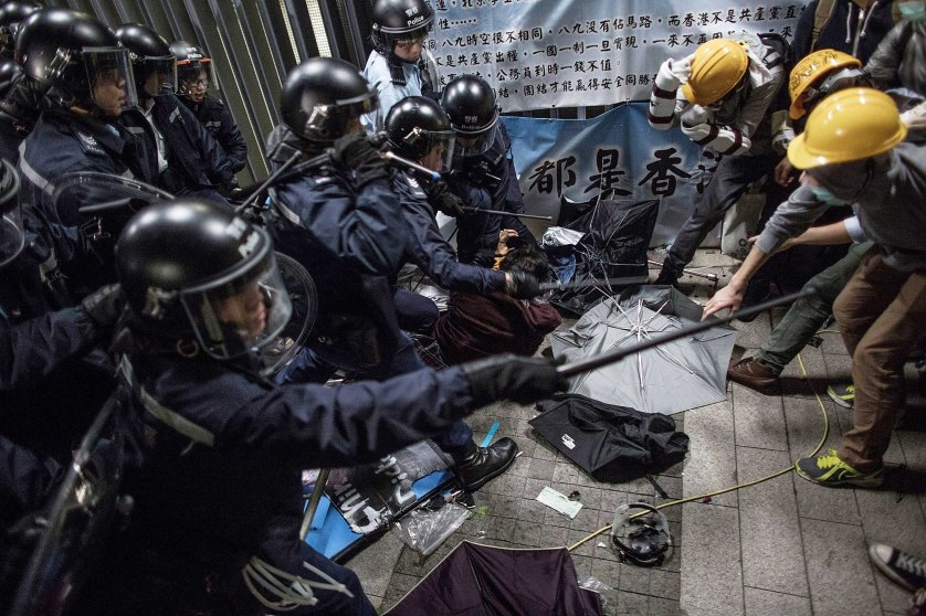 Police officers disperse pro-democracy protesters outside the Legislative Council building after clashes with pro-democracy activists on Nov. 19, 2014 in Hong Kong.
